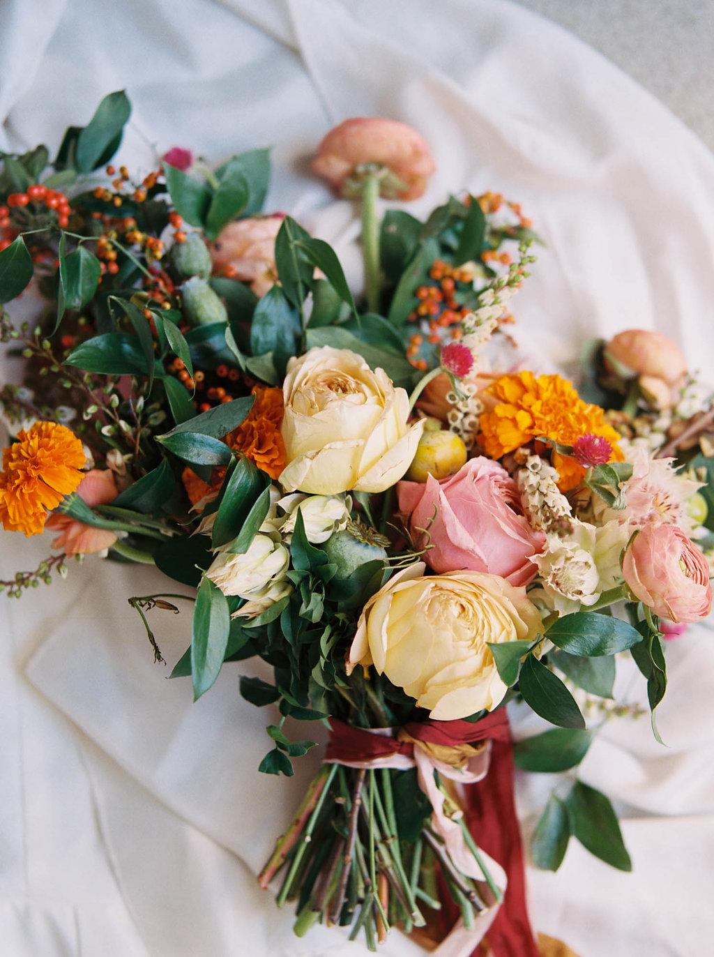 Bright, summery bridal bouquet with rosy pink garden roses and orange marigolds // Nashville Wedding Floral Design