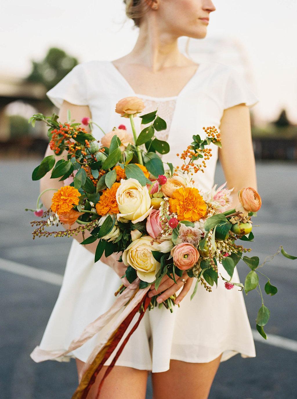 Summer bridal bouquet with orange, rosy pink, and golden yellow flowers // Nashville Wedding Florist