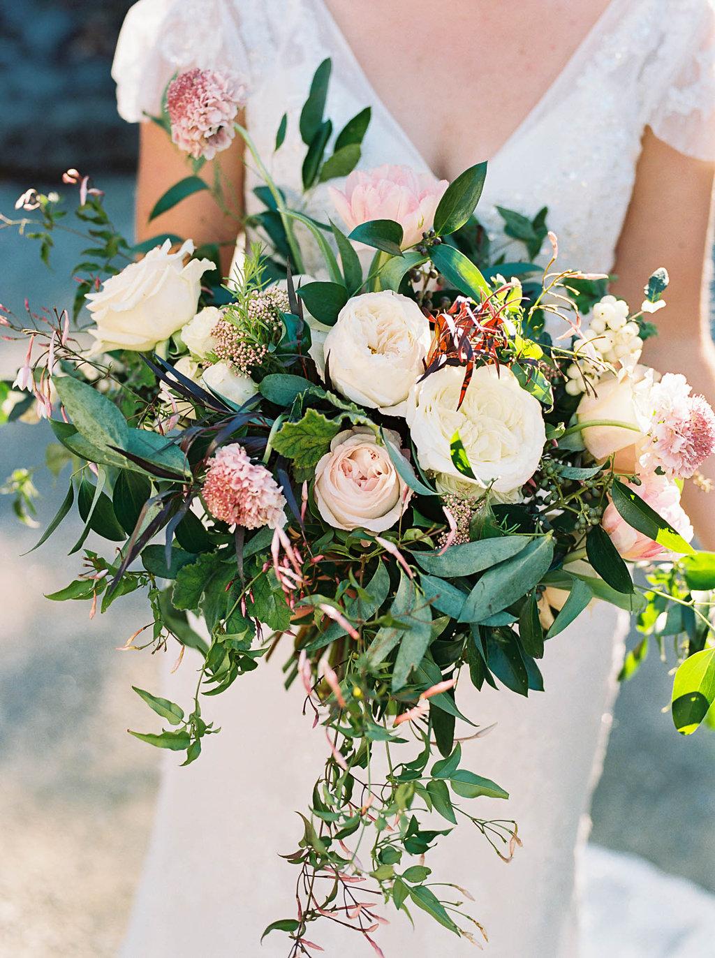 Lush, natural bridal bouquet with blush garden roses, tulips, ranunculus, and greenery // Nashville Wedding Florist