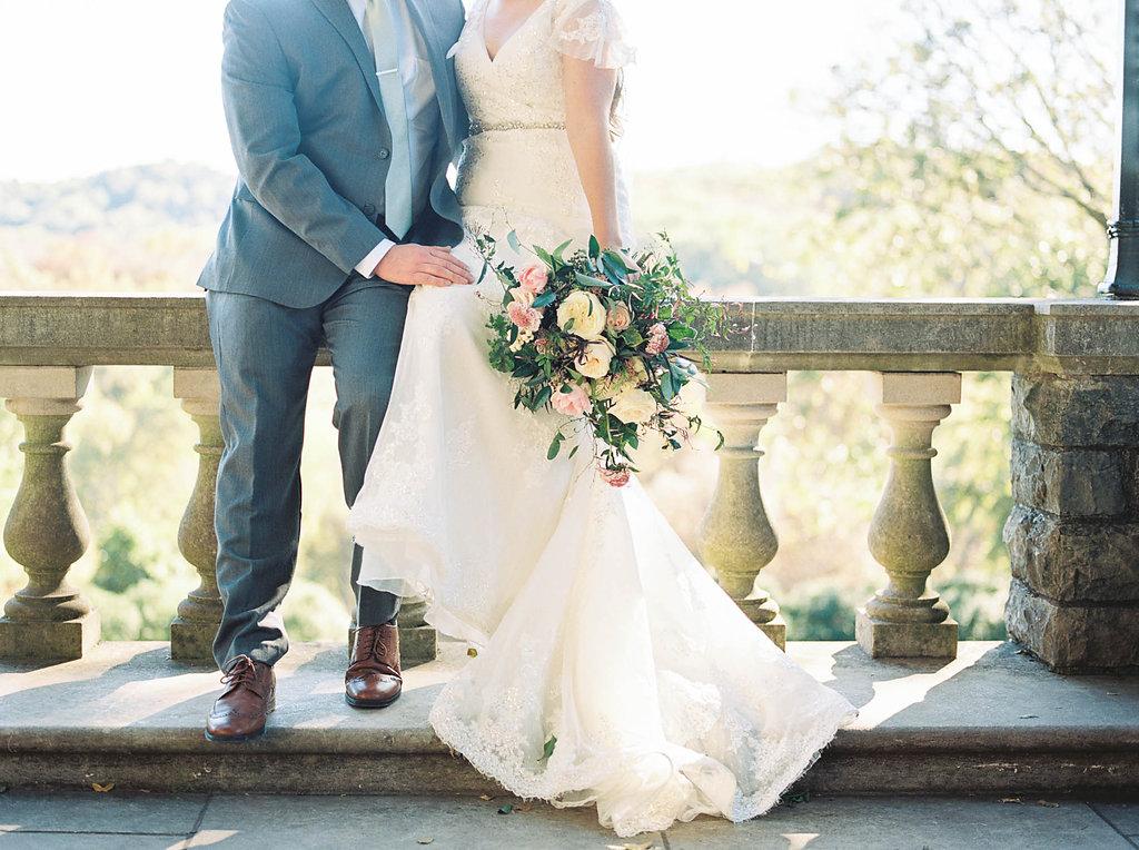 Lush, natural bridal bouquet with garden roses, tulips, blush ranunculus, and greenery in botanical garden // Nashville Wedding Florist