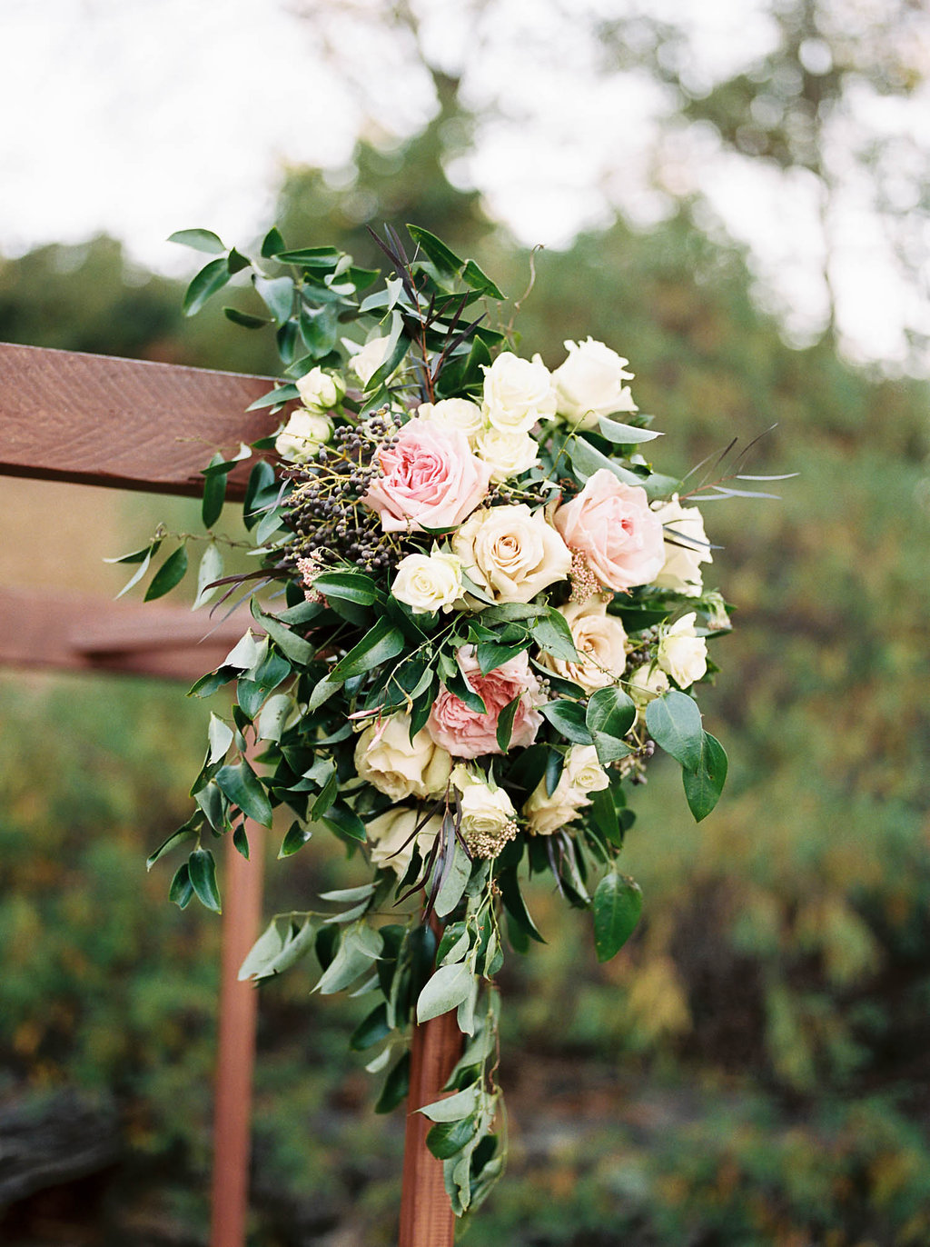 Simple wooden chuppah with lush, natural flowers // Nashville Wedding Florist