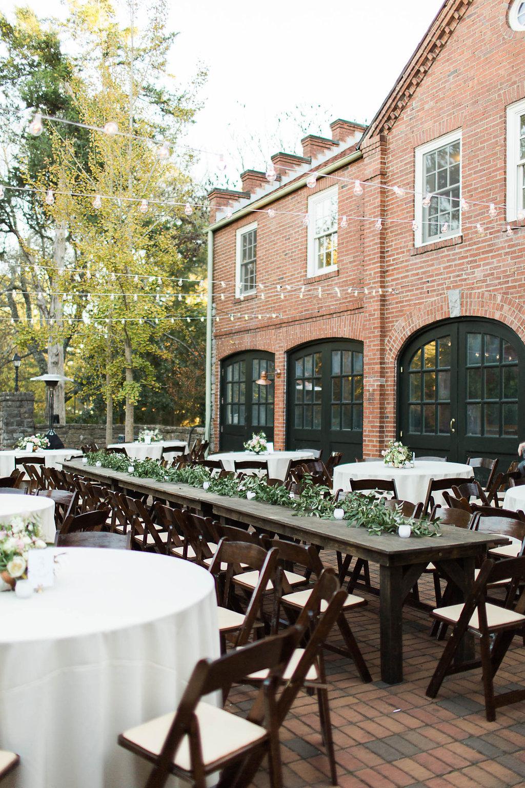 Lush greenery garland for the head table // Nashville Wedding Florist