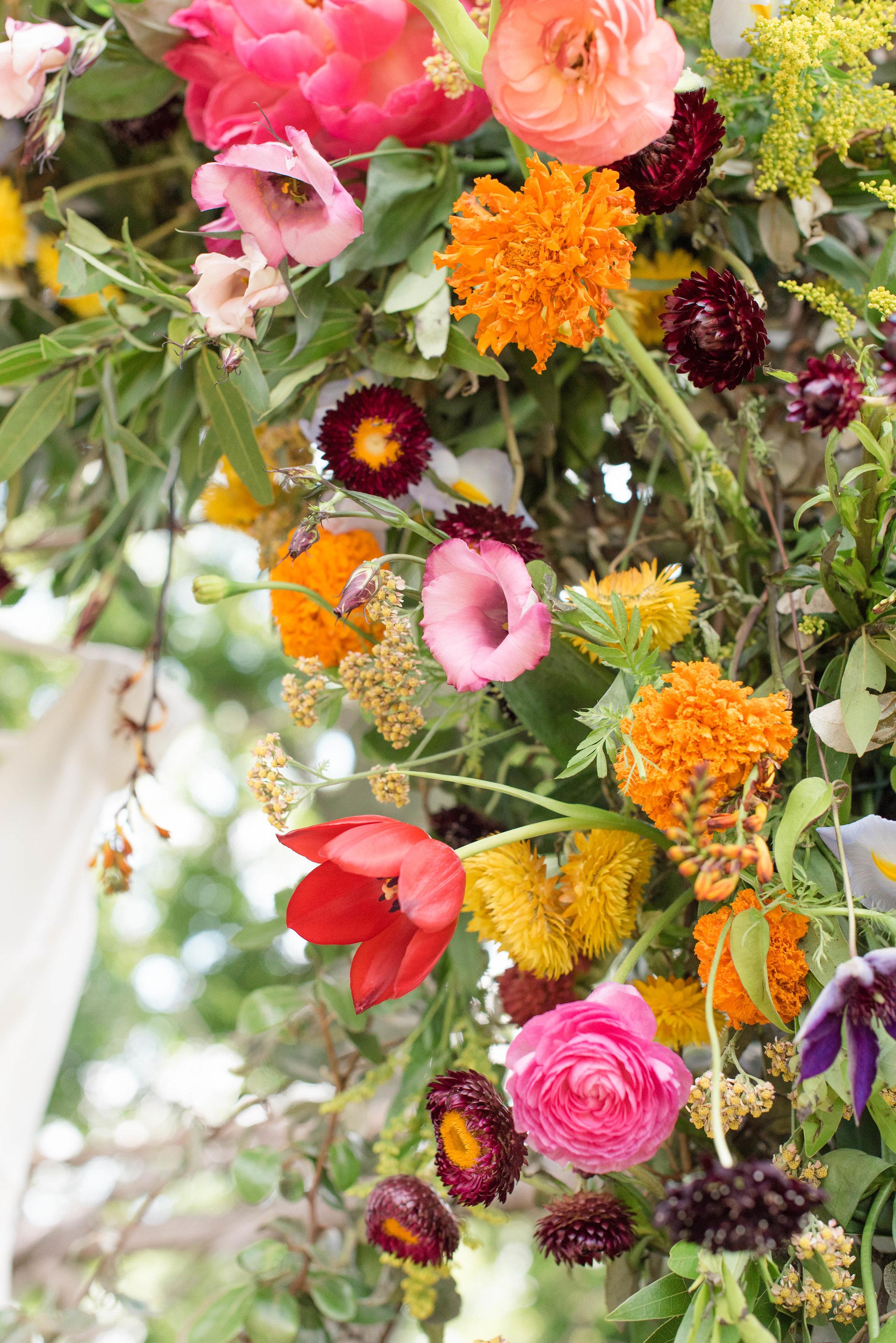 Lush, brightly colored arbor for wedding backdrop // Nashville Wedding Florist