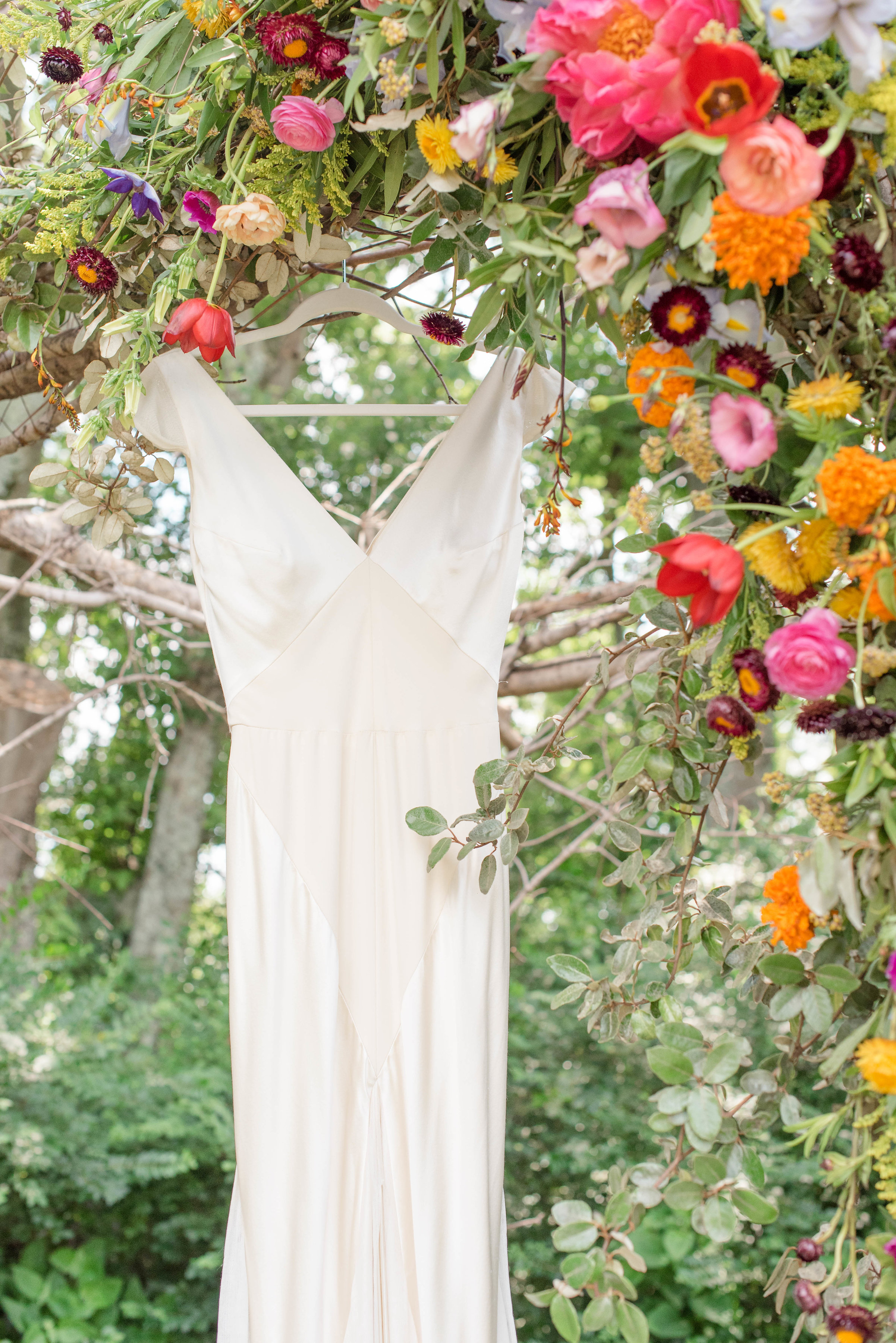 Lush garden arch with peonies, tulips, and ranunculus // Nashville Wedding Floral Design