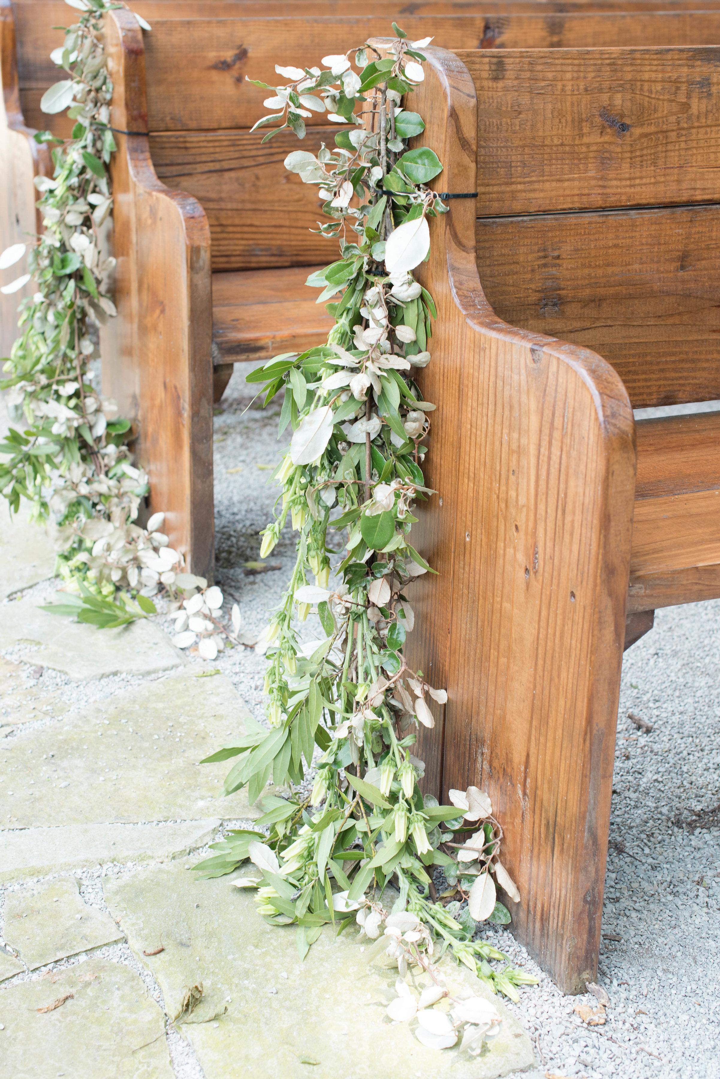 Trailing greenery aisle markers on wooden pews // Nashville Wedding Floral Design