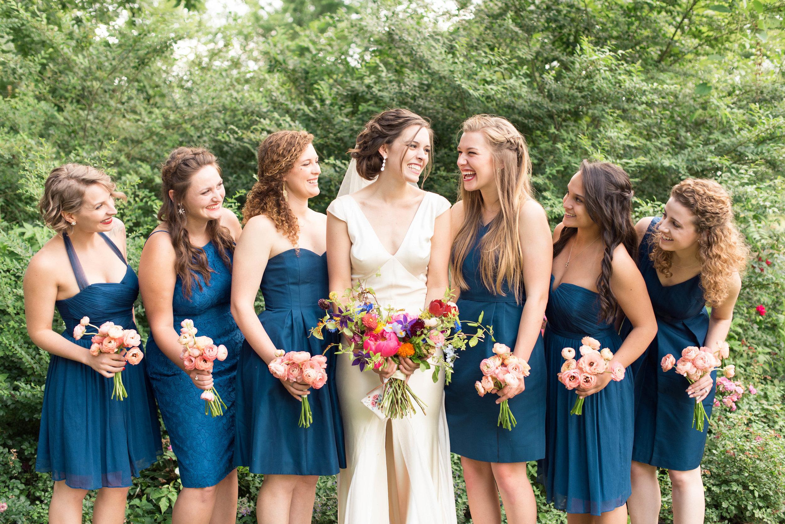 Lush, bright bridal bouquet // Peach ranunculus bridesmaid bouquets // Chagall Painting Inspired Wedding Flowers