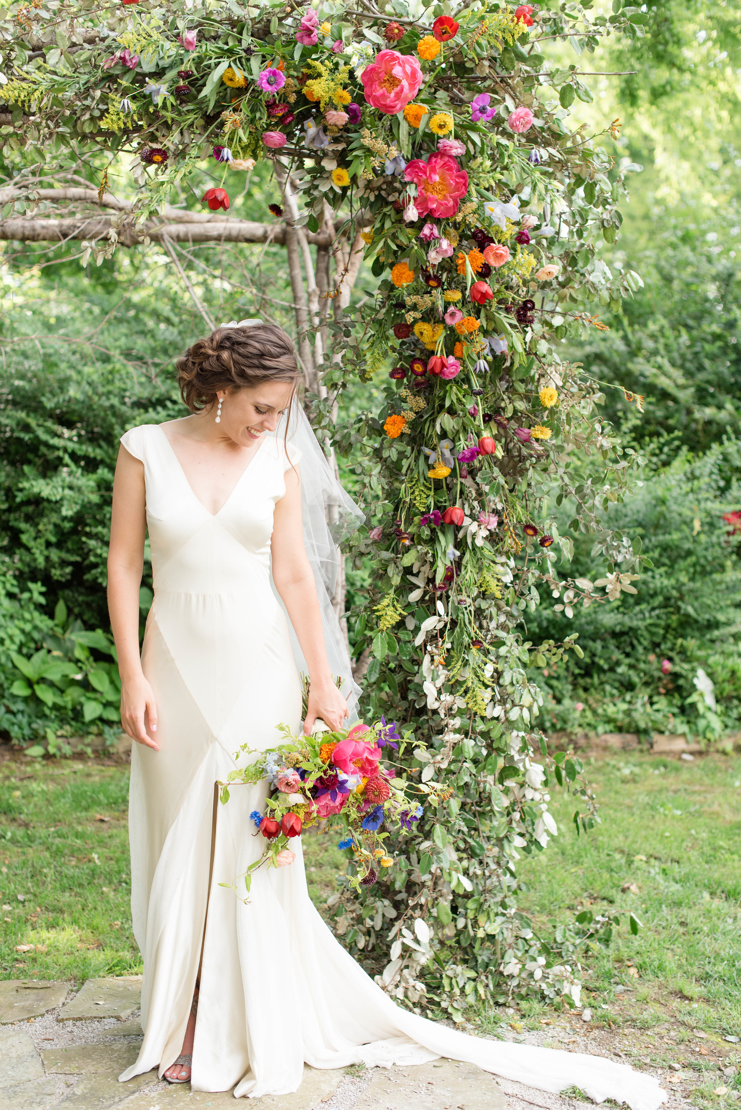 Lush, bright bridal bouquet with peonies, ranunculus, tulips, and cornflower // Chagall Painting Inspired Wedding Flowers