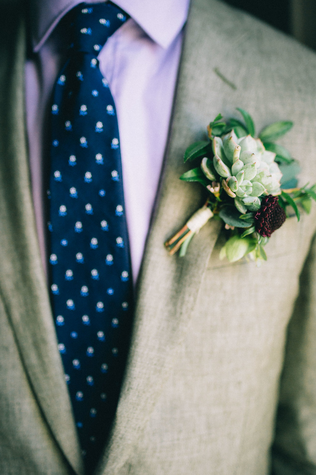 Succulent boutonniere with touches of burgundy // Nashville Wedding Flowers