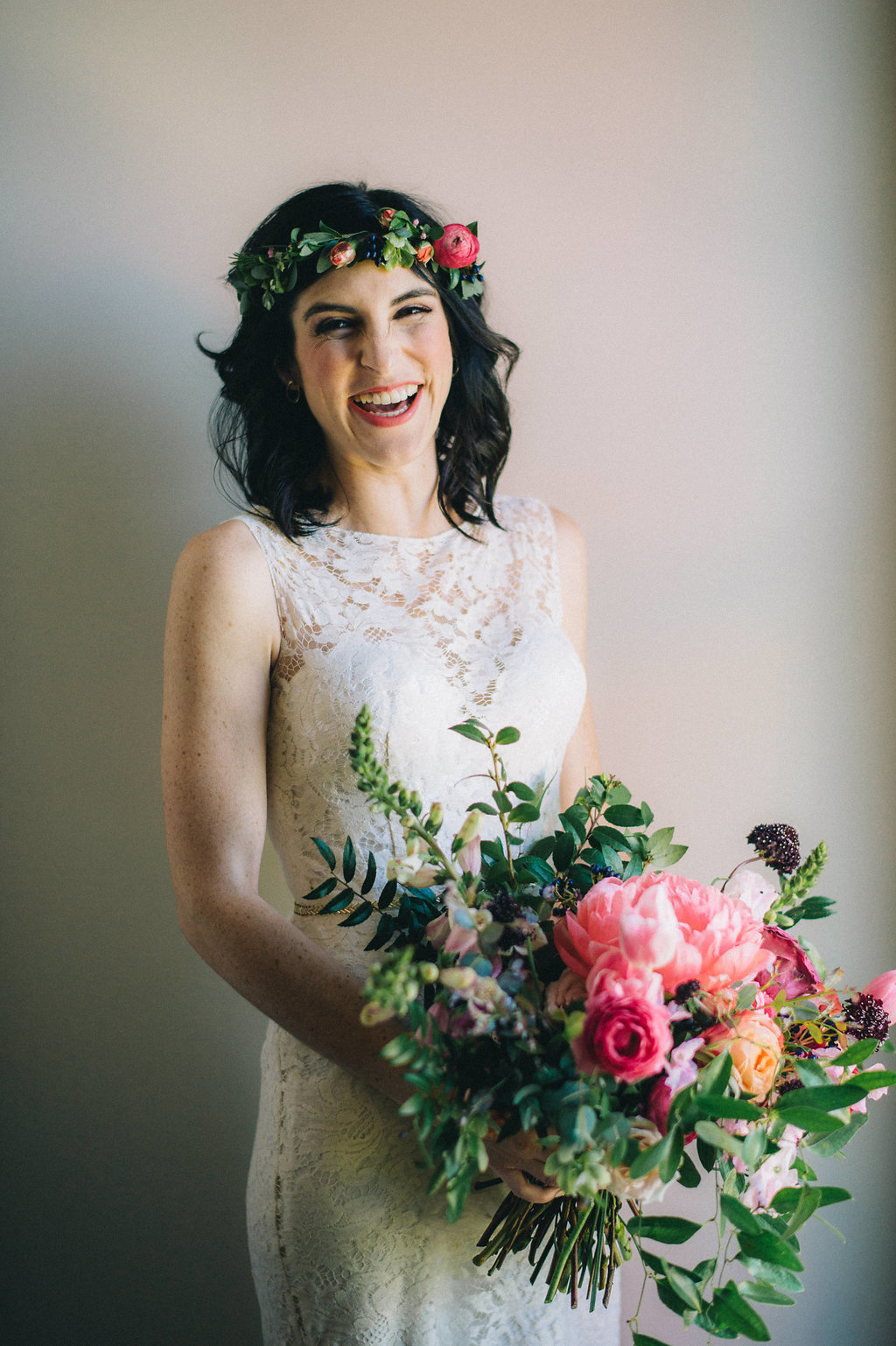 Lush bridal bouquet with coral charm peonies, tulips, ranunculus, and sweet peas // Nashville Wedding Floral Designer