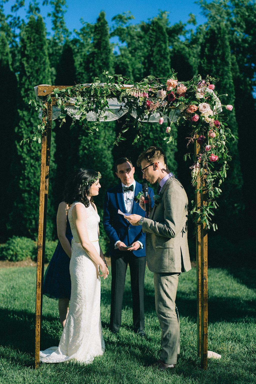 Simple wooden chuppah with heirloom lace and lush, brightly colored florals // Nashville Wedding Floral Designer