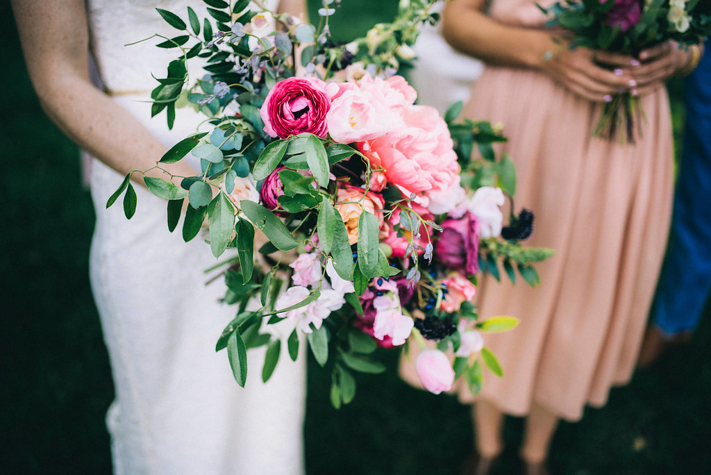 Lush, berry toned bridal bouquet with peonies and ranunculus // Nashville Wedding Florist