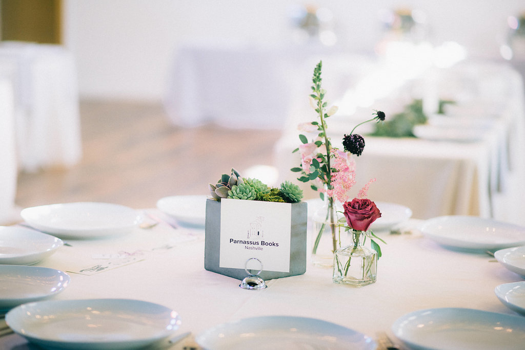Succulent in a stone box and simple berry toned bud vases // Southeastern Wedding Floral Design