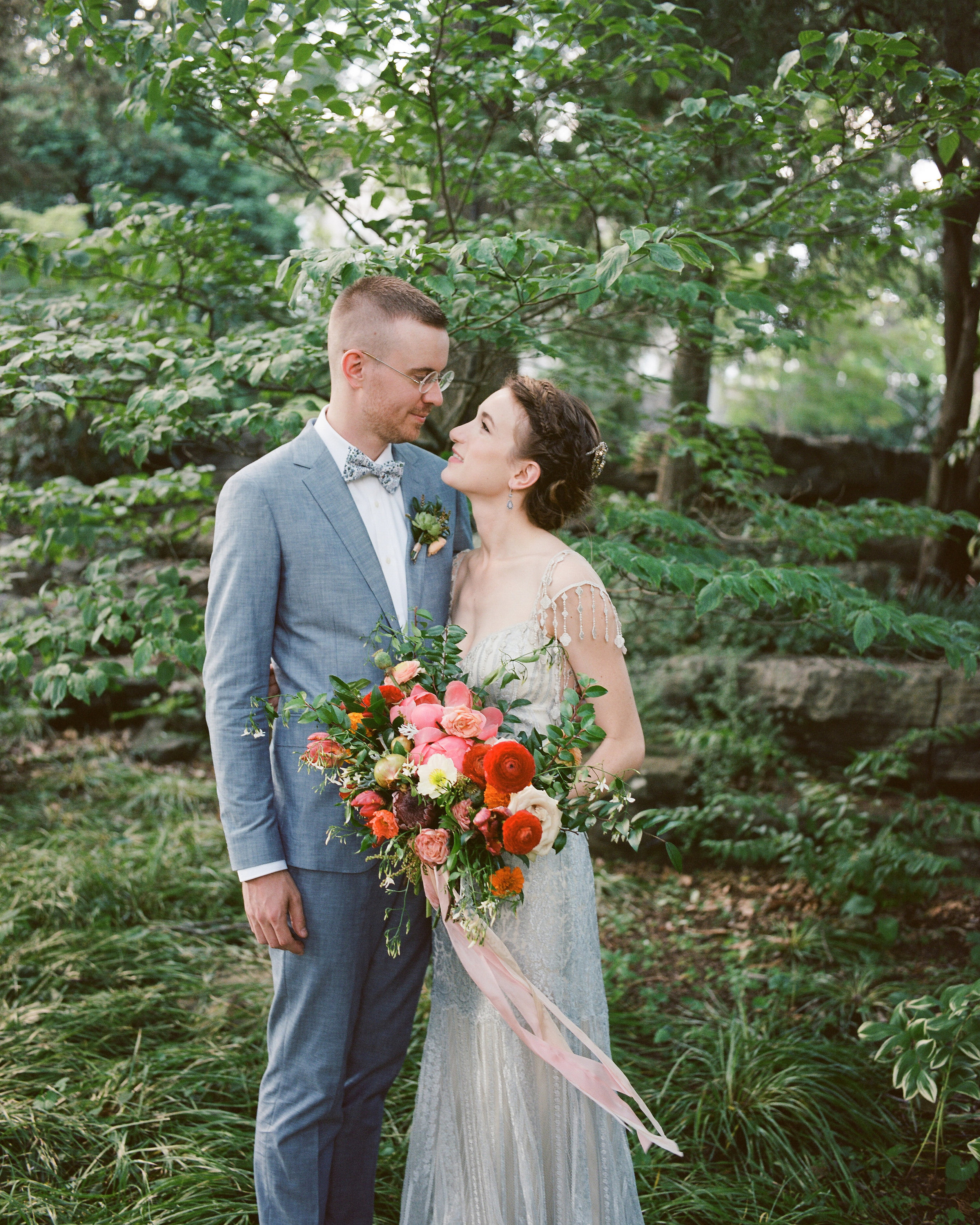 Lush, brightly colored bridal bouquet with ranunculus, peonies, and Icelandic poppies, silvery blue wedding dress // Nashville Wedding Florist