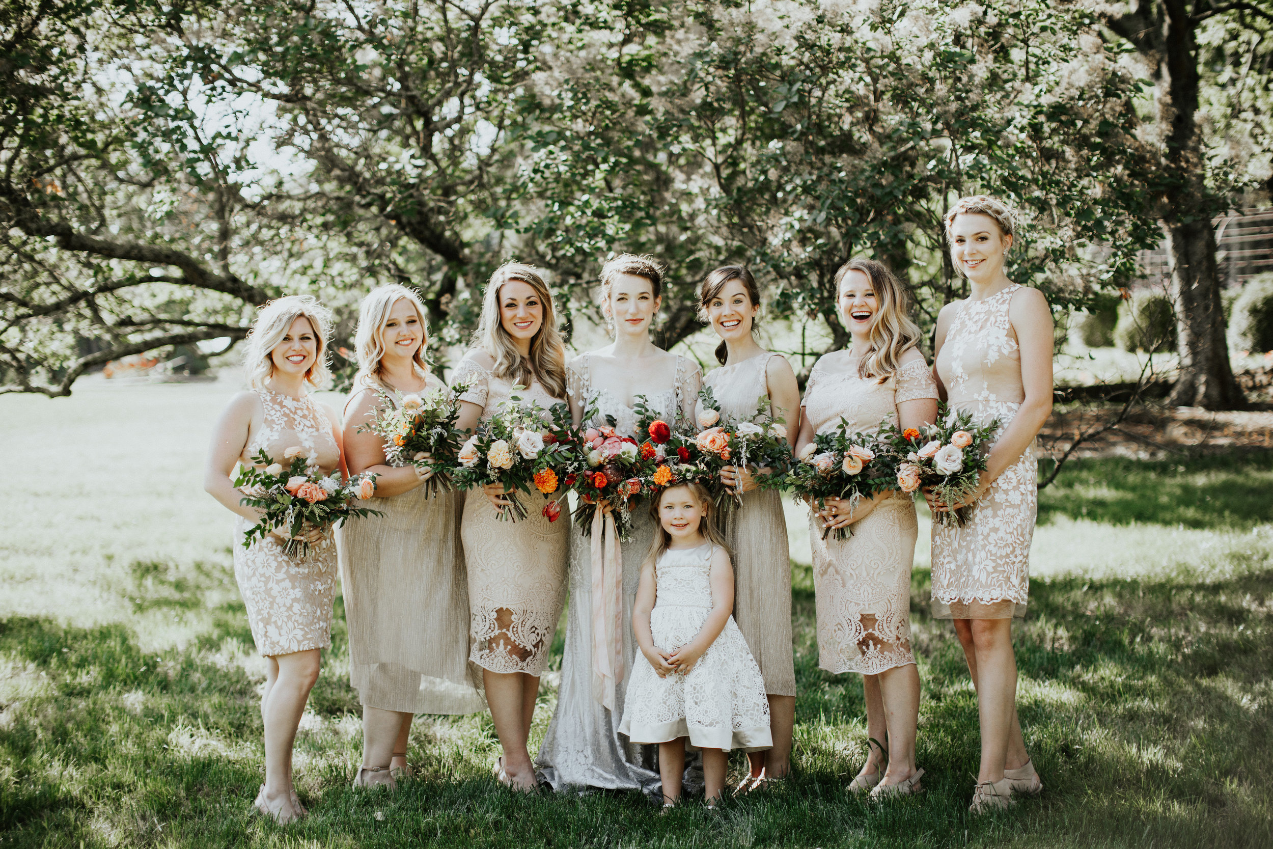 Neutral bridesmaid dresses with silvery blue wedding dress // Organic, natural floral design in Nashville