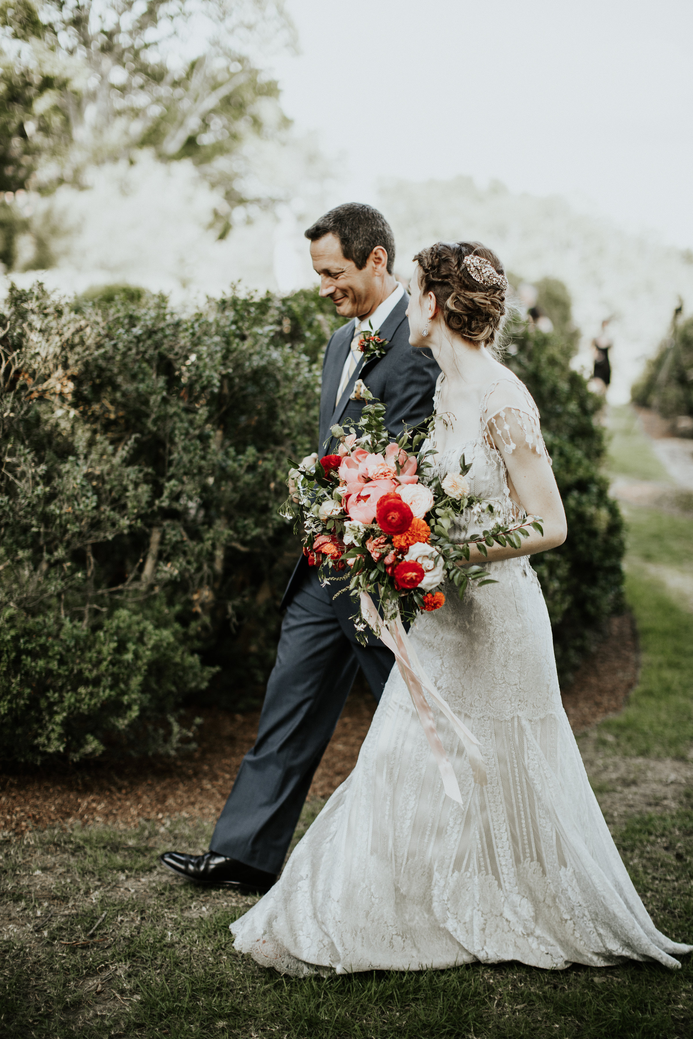 Father walking the bride down the aisle // Botanic garden wedding with lush, organic floral design in Nashville
