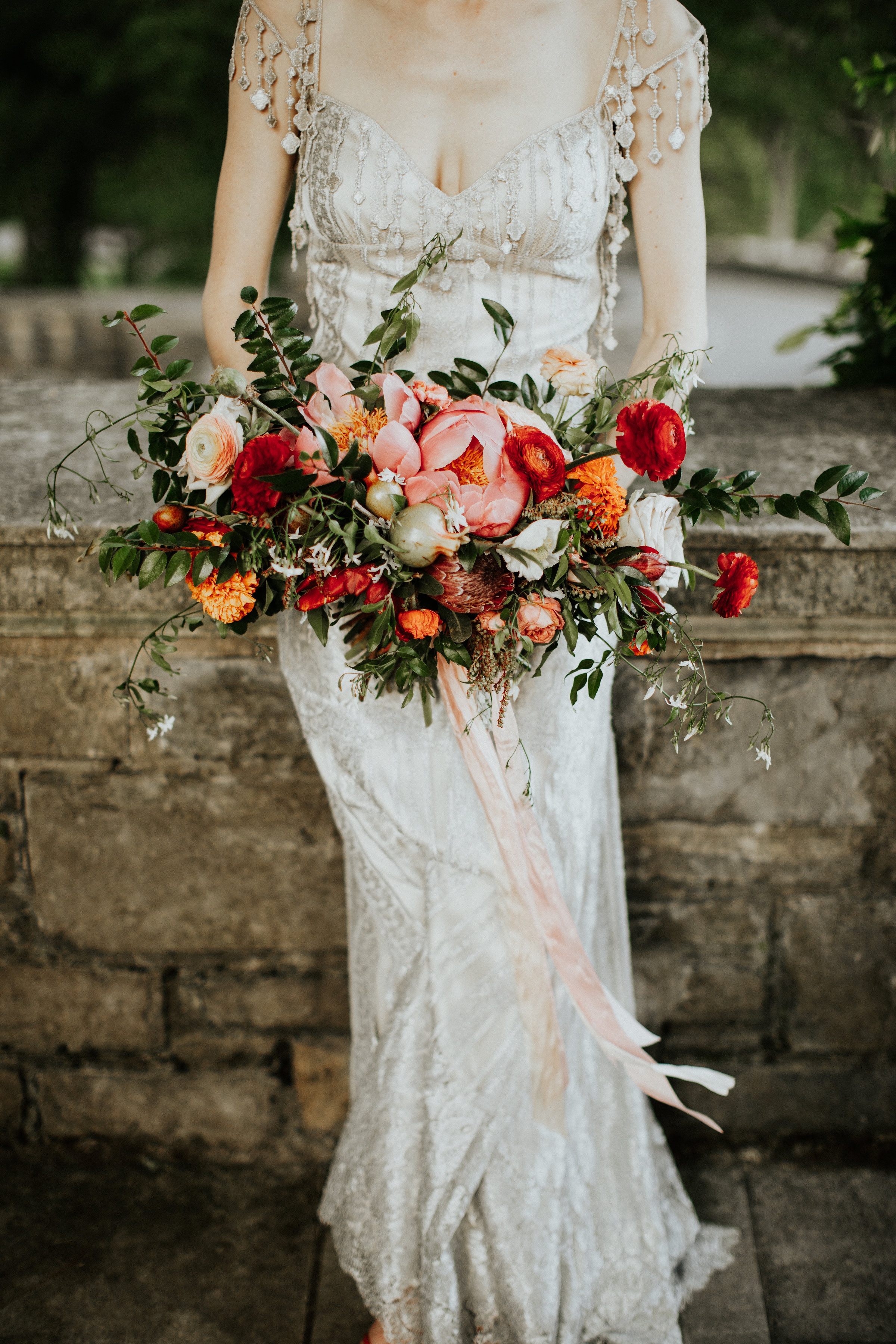 Bridal bouquet with ranunculus, pomegranates, peonies, and natural, untamed greenery // Nashville Wedding Florist