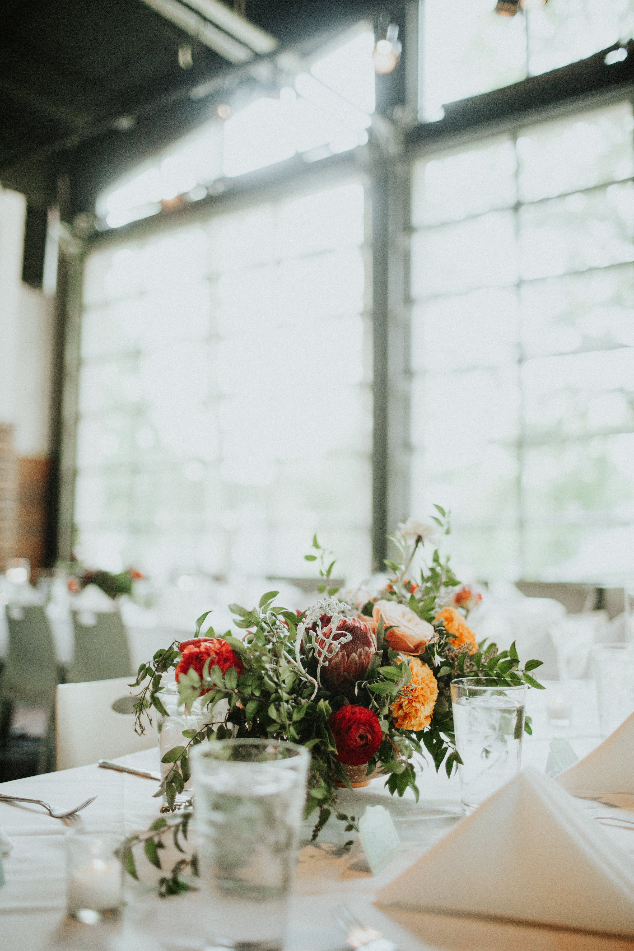 Bright summery centerpiece with organic, trailing greenery // Nashville Wedding Floral Design