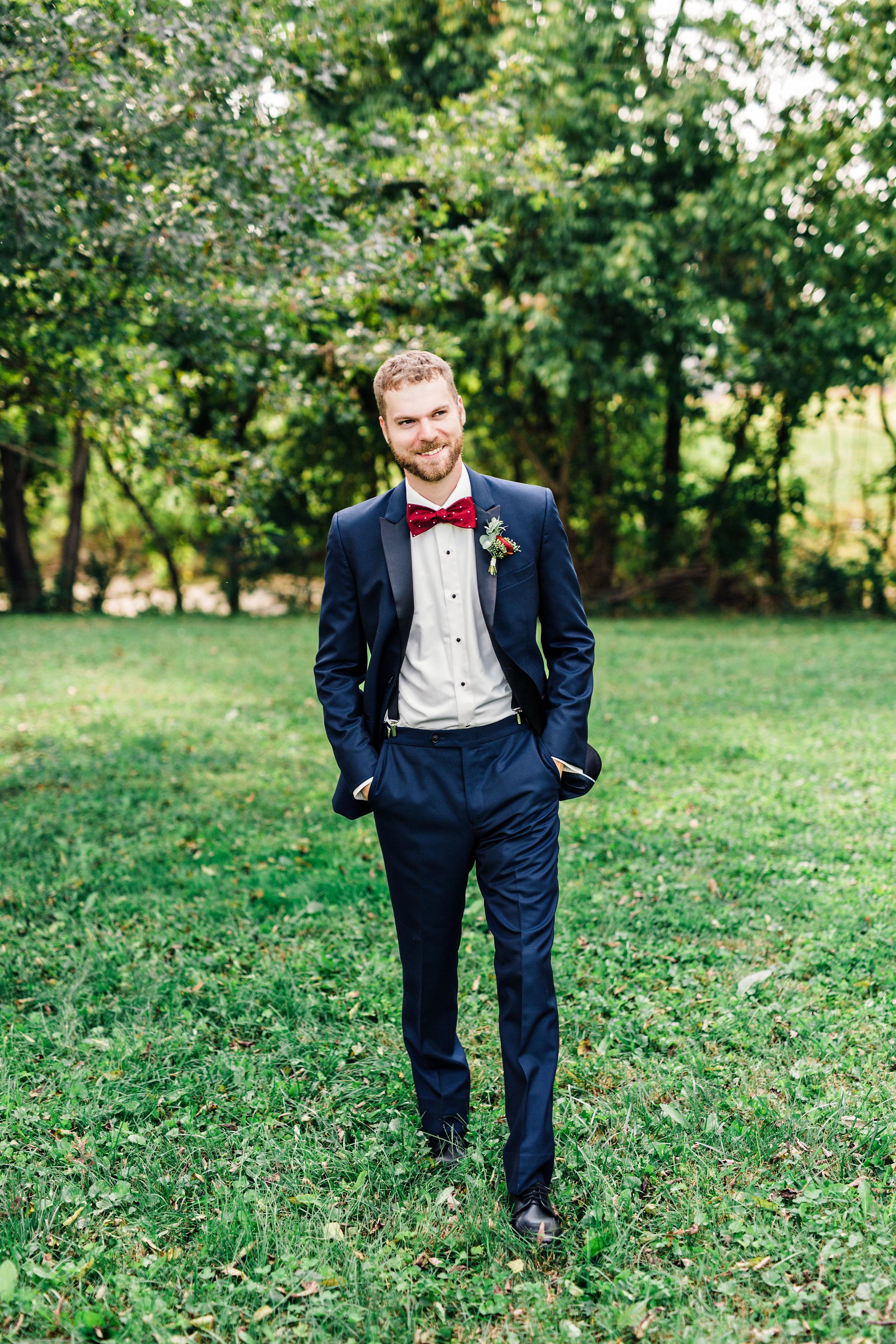 Deep red ranunculus boutonniere // Nashville Wedding Florist