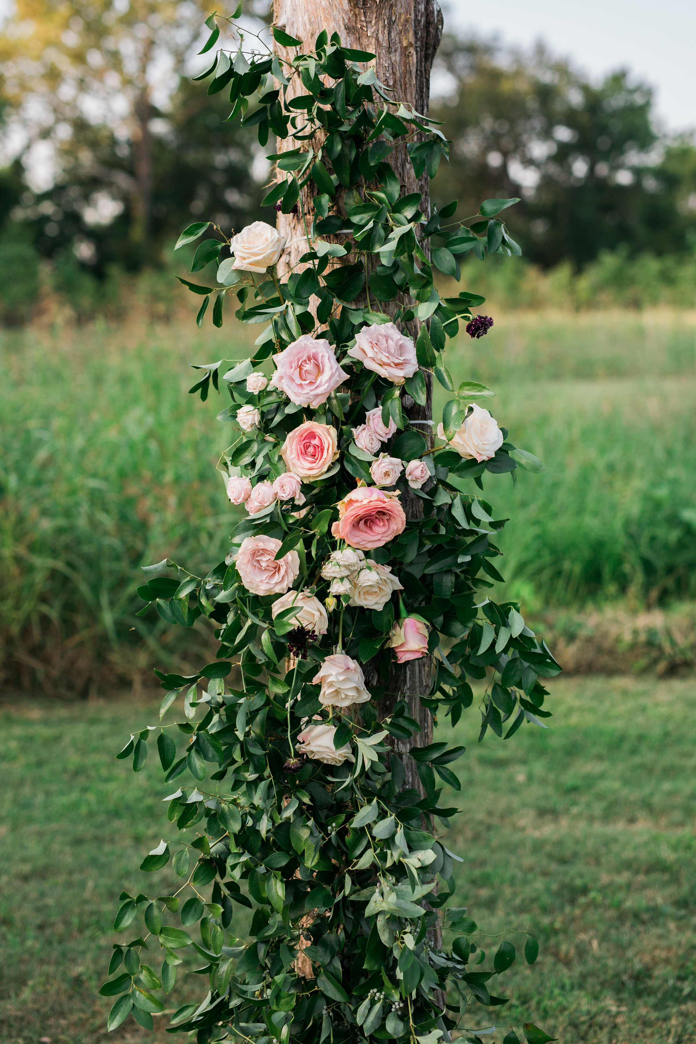 Simple wooden arbor with lush floral in shades of marsala and blush // Nashville Wedding Floral Design