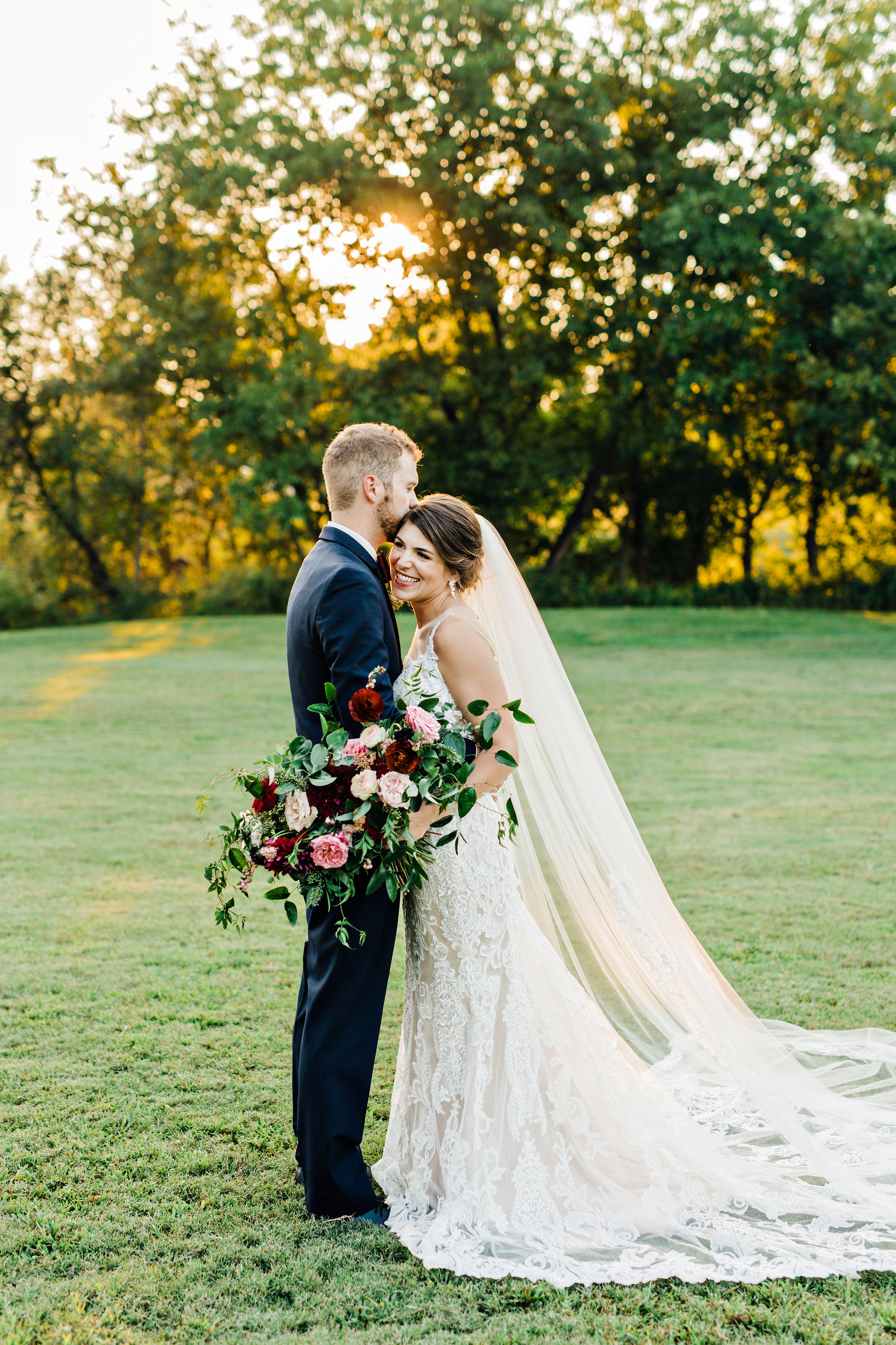 Sunset bride and groom portraits // Lush  marsala wedding florals