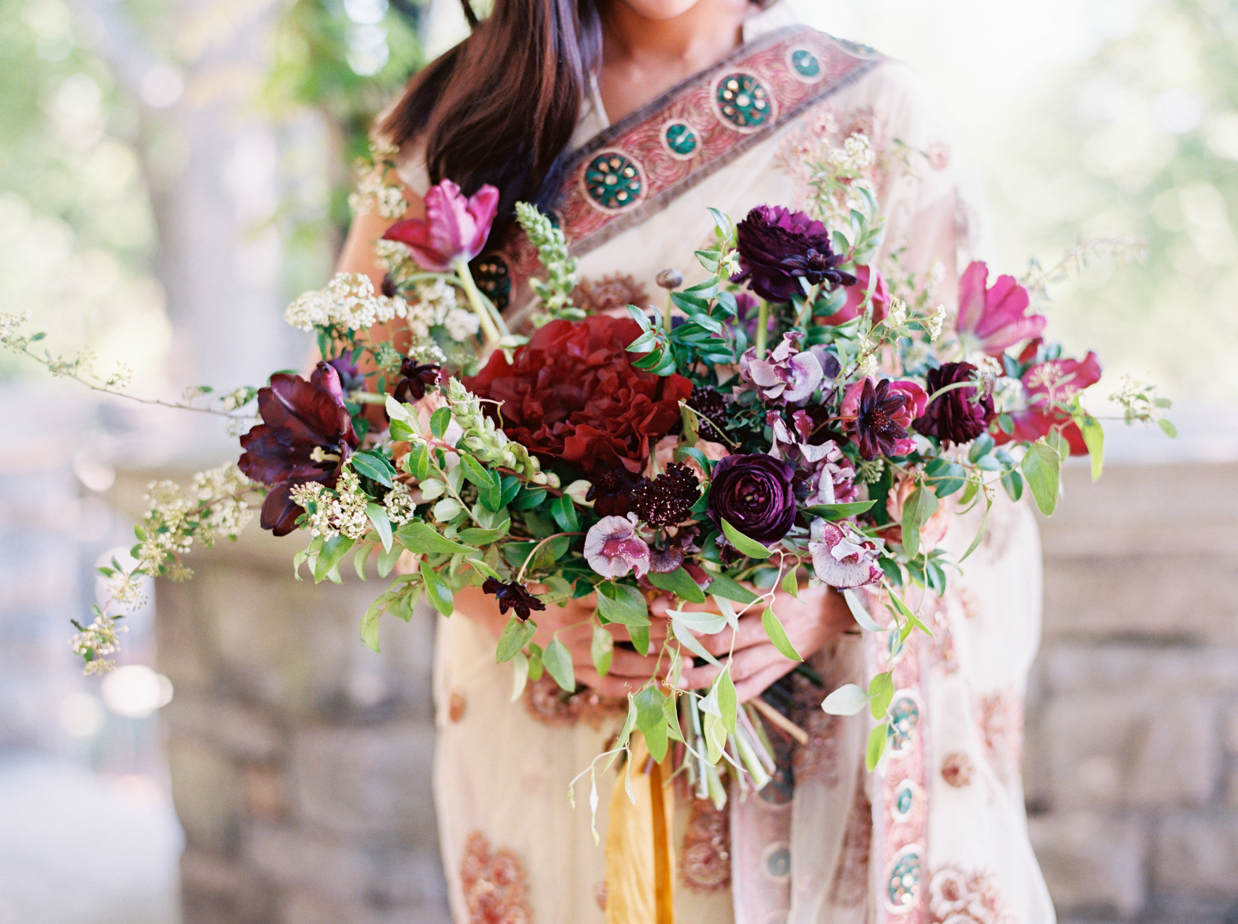 Indian Bridal Portraits at Cheekwood // Lush, untamed bridal bouquet in shades of plum and marsala