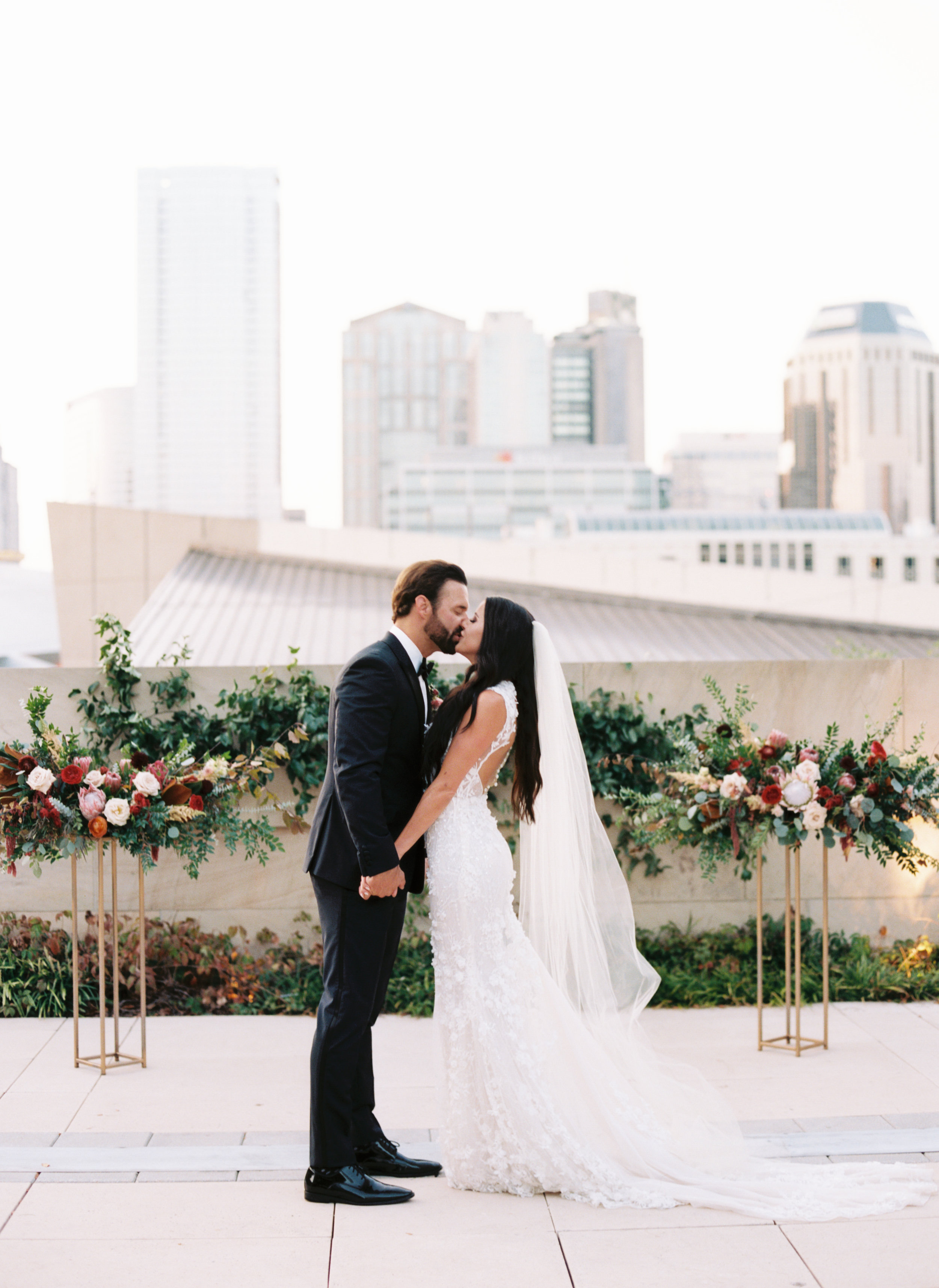 Blush and marsala wedding flowers with protea, ranunculus, and lots of greenery and texture // Country Music Hall of Fame Wedding, Nashville
