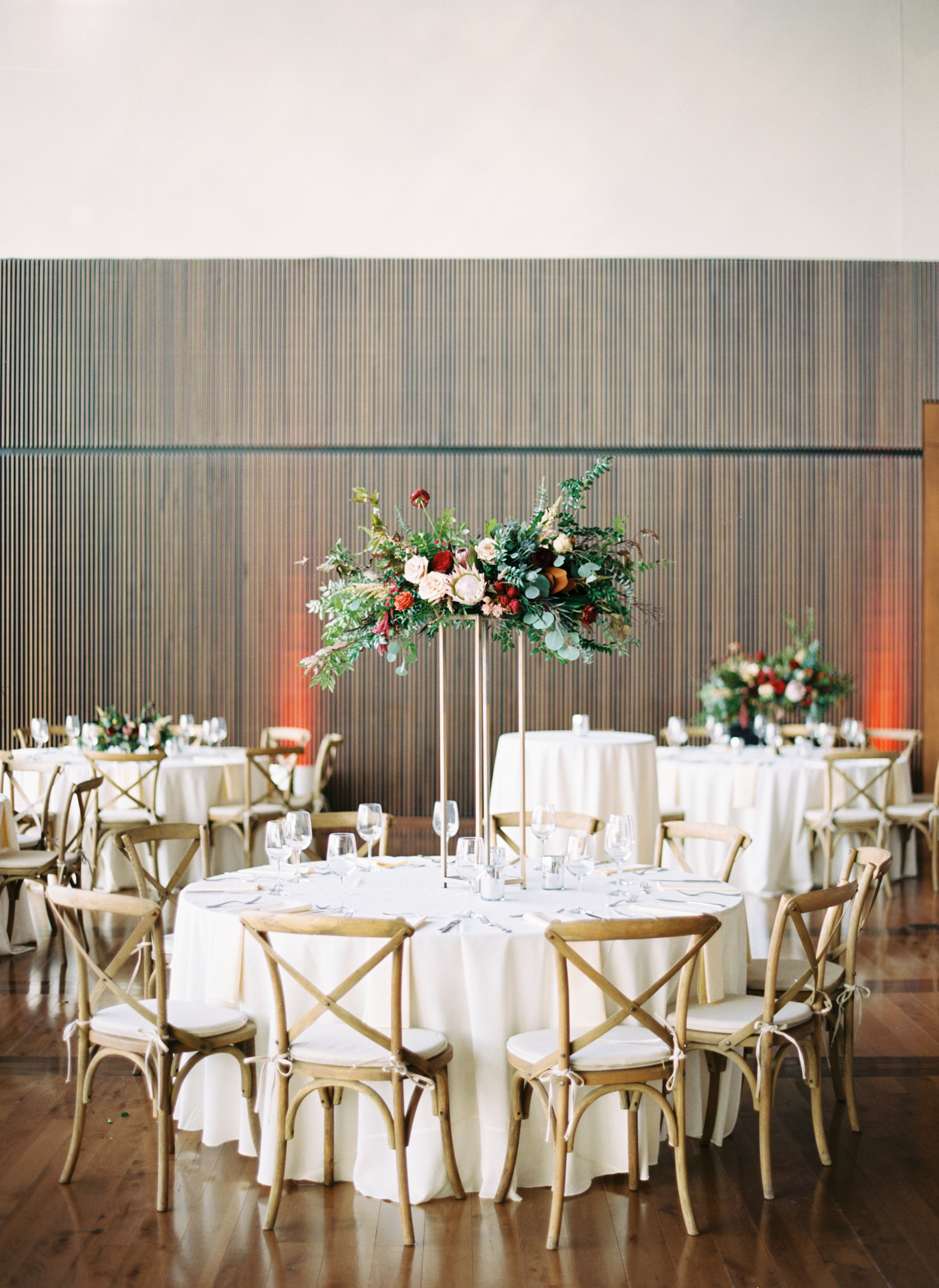 Blush and marsala centerpieces with protea, ranunculus, and lush greenery // Country Music Hall of Fame Wedding, Nashville