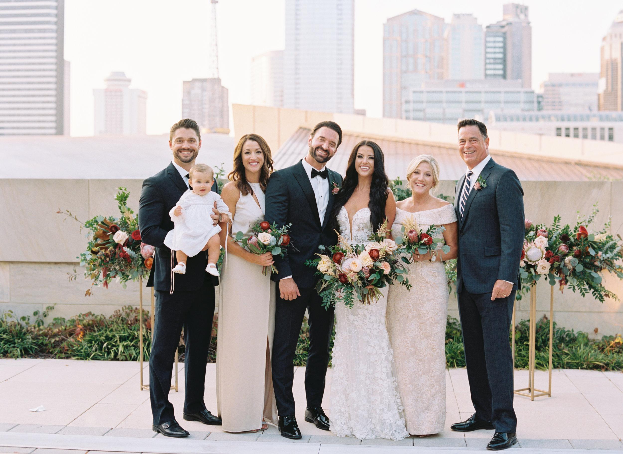 Family portraits with the Nashville skyline // Lush, untamed wedding flowers
