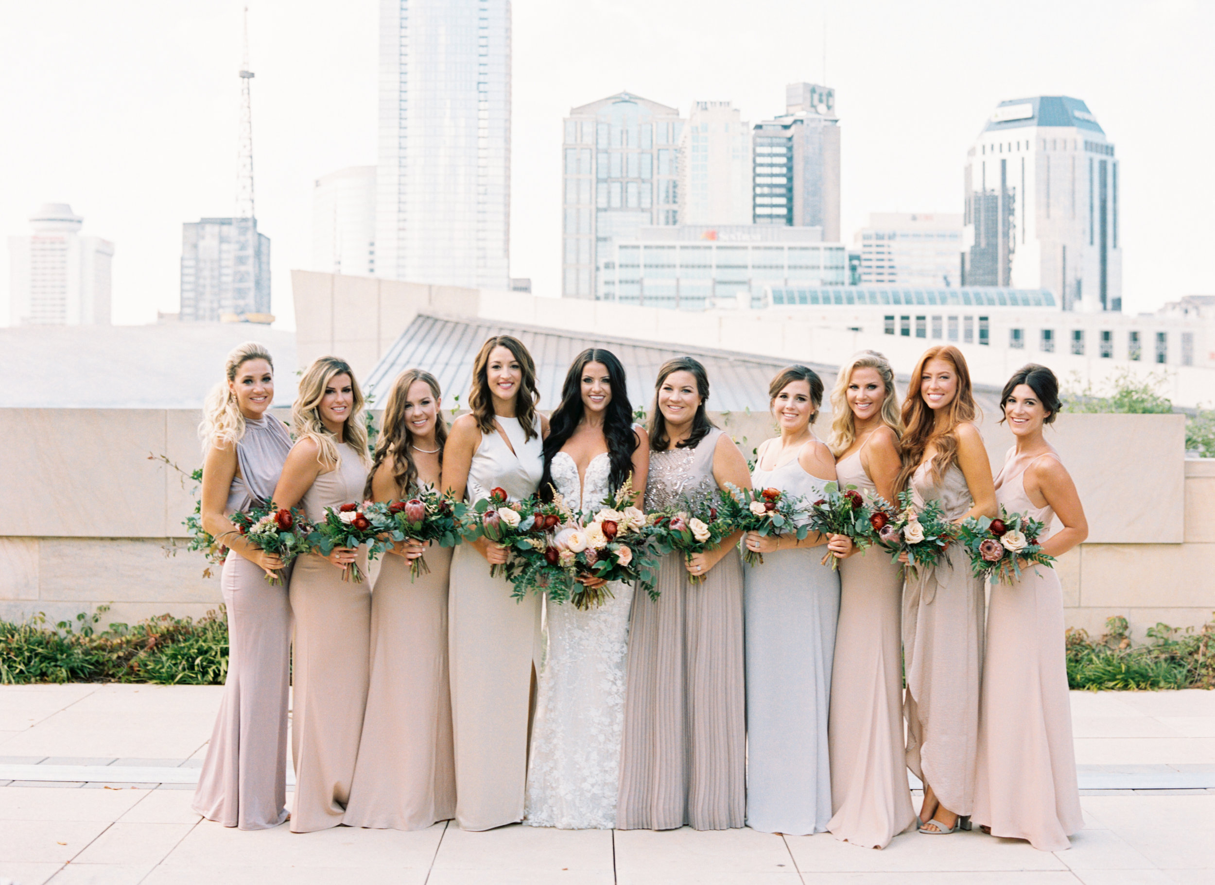Muted pastel bridesmaid style with pops of marsala and burgundy florals // Nashville Wedding Floral Design