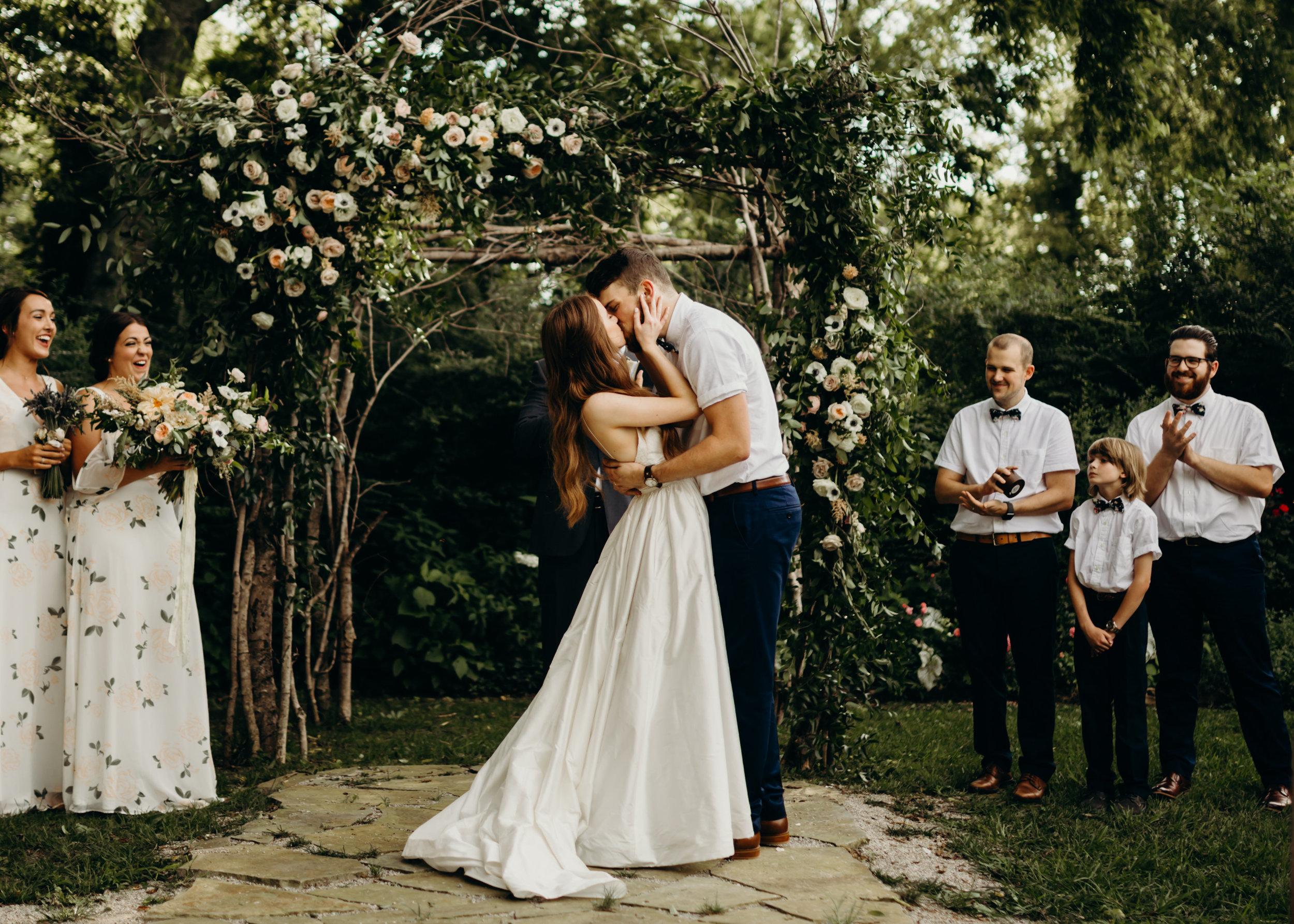 Natural, organic floral arbor installation for the wedding ceremony backdrop // Nashville Wedding Floral Designer