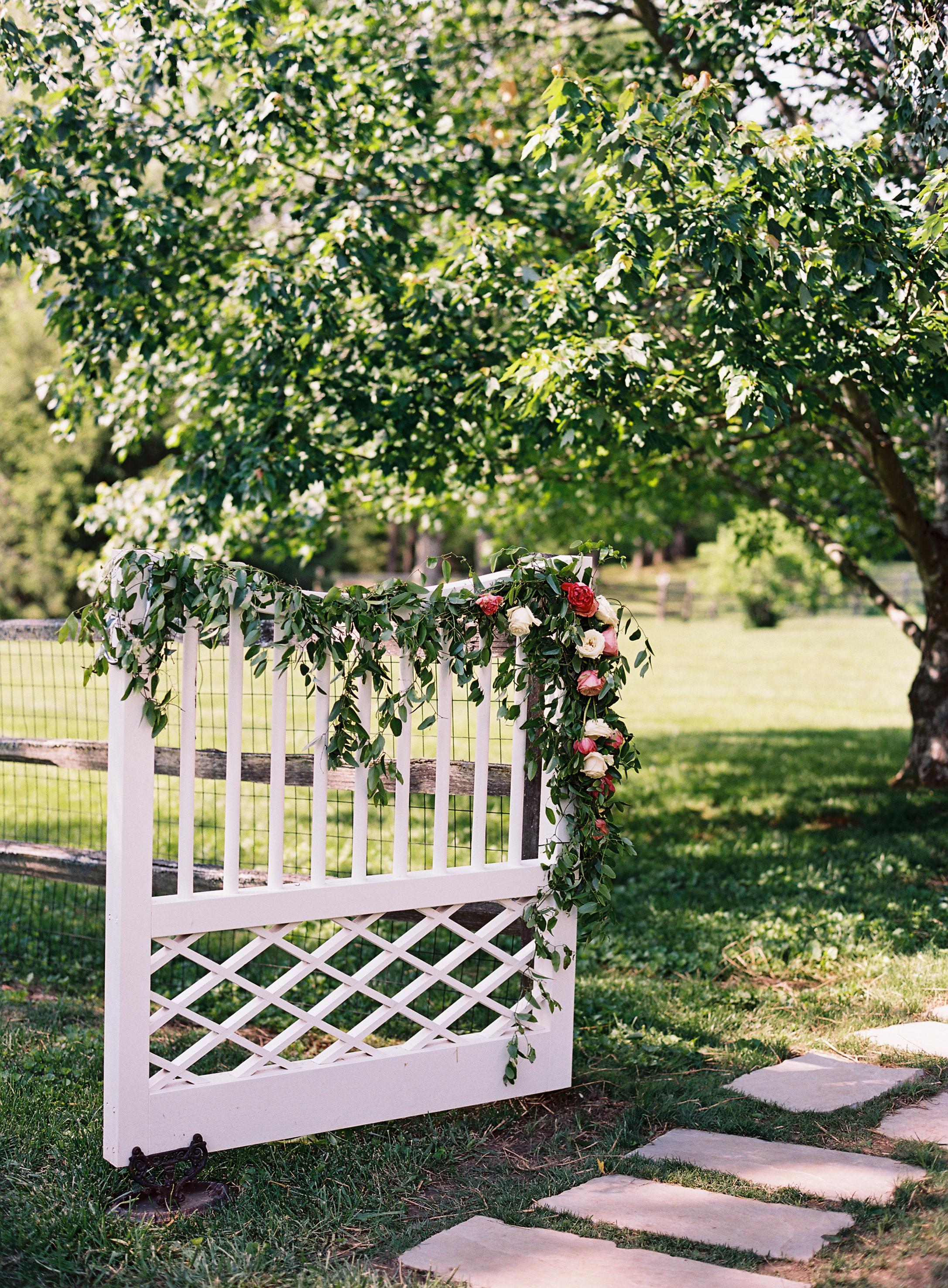 Lush, trailing garland on the gate  // Nashville Wedding Floral Design