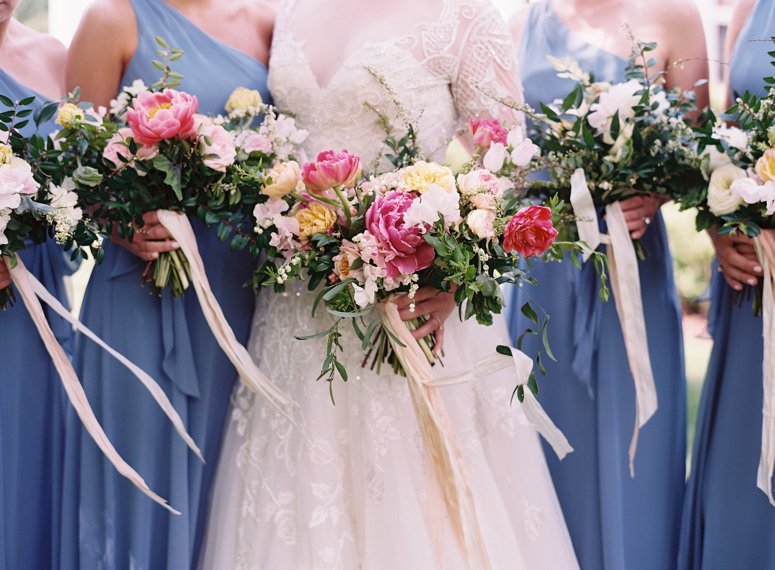 Lush bridal bouquet of peonies, tulips, lily of the valley, garden roses, and sweet peas with streaming silk ribbon // Nashville Wedding Floral Design