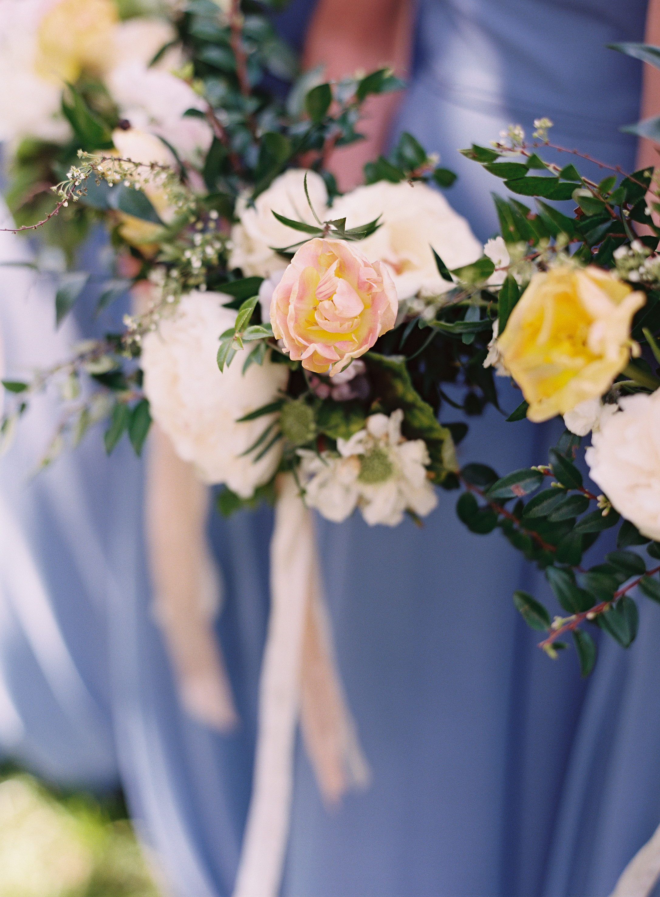Tulips, spirea, and natural greenery bridesmaid bouquets // Franklin Wedding Florist