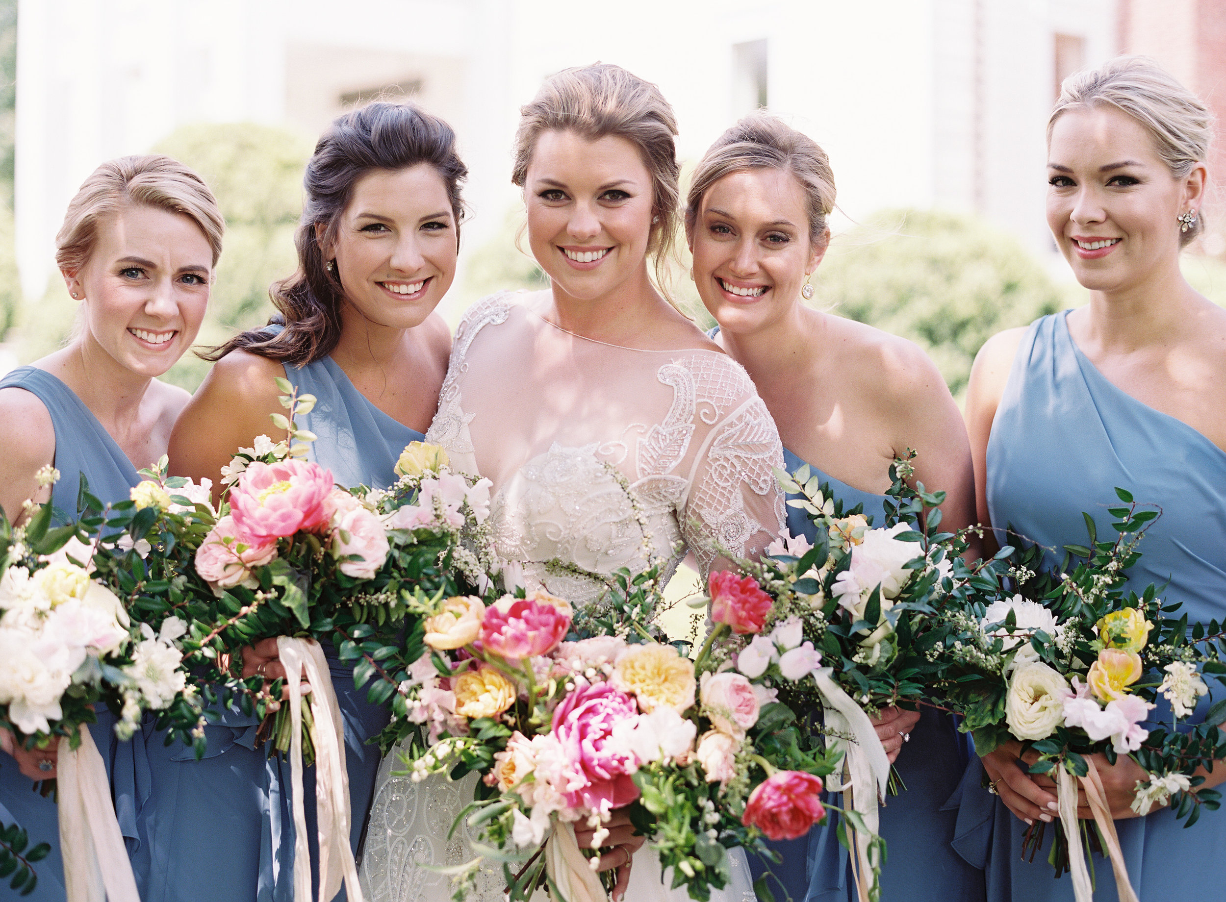 Lush bridal bouquet of peonies, tulips, lily of the valley, garden roses, and sweet peas  // Nashville Wedding Floral Design