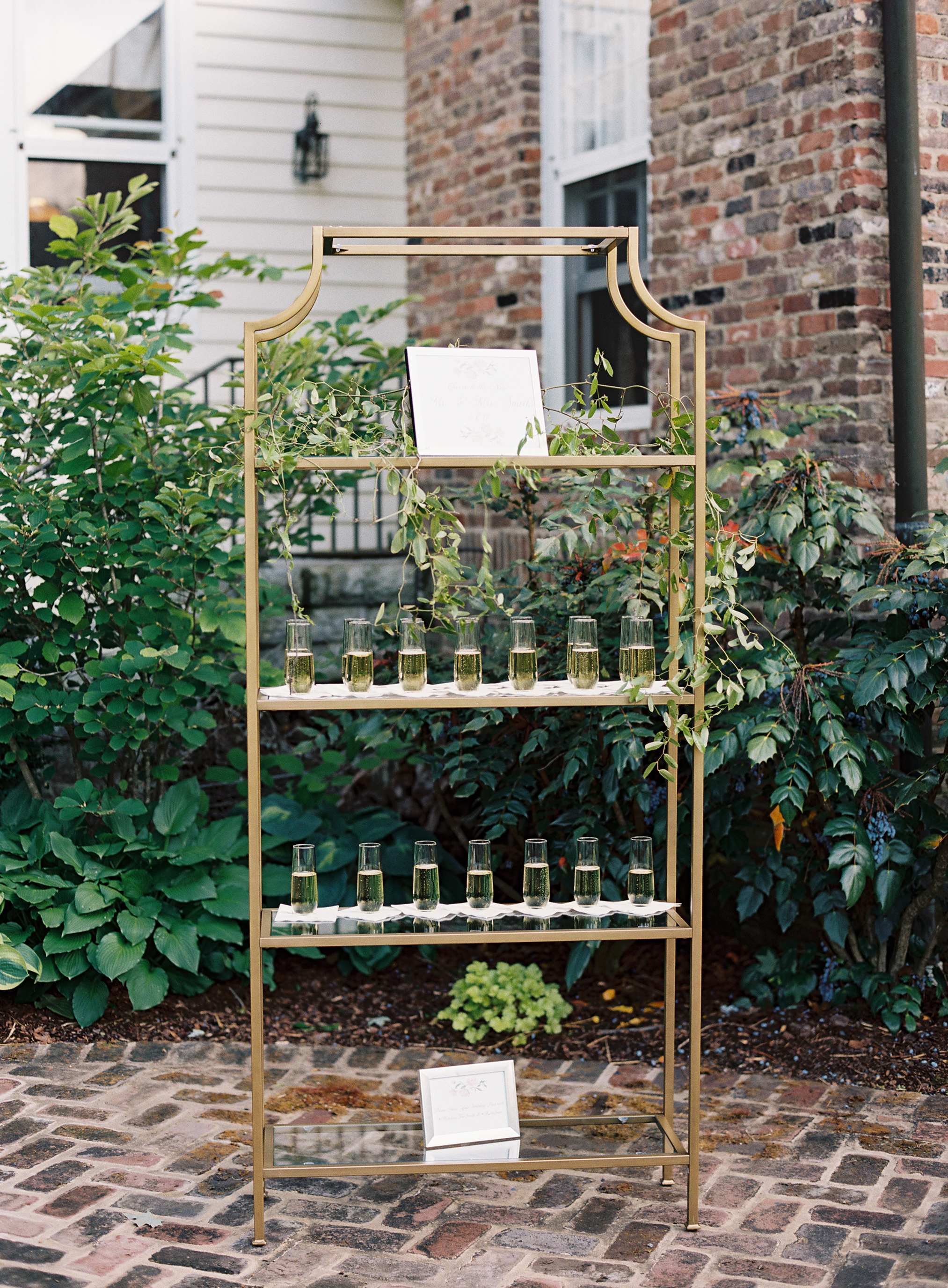 Champagne stand to welcome guests // Nashville Wedding Florist