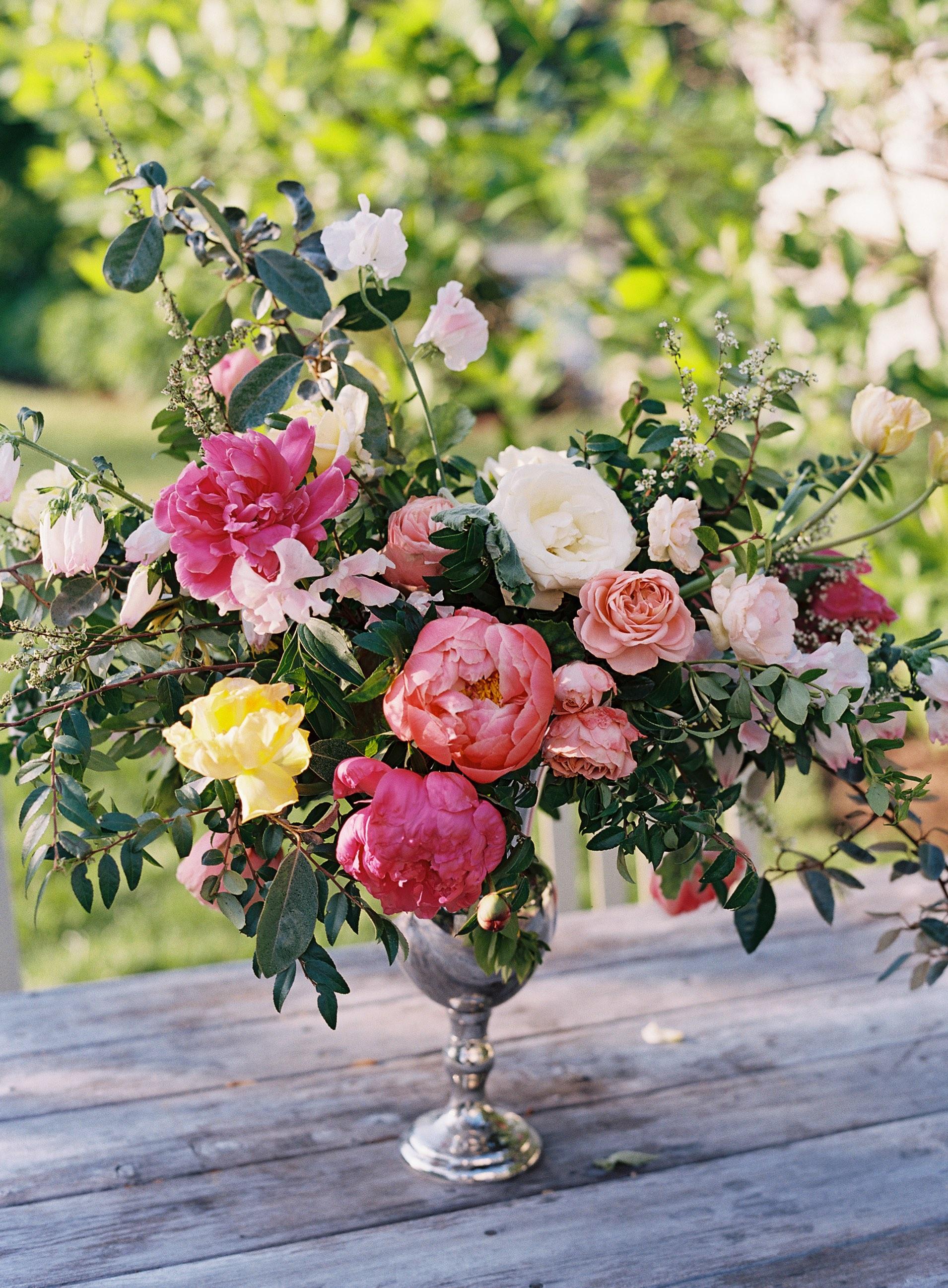 Organic arrangement with homegrown pink peonies, blush sweet peas, spirea, lush greenery // Nashville Wedding Florist