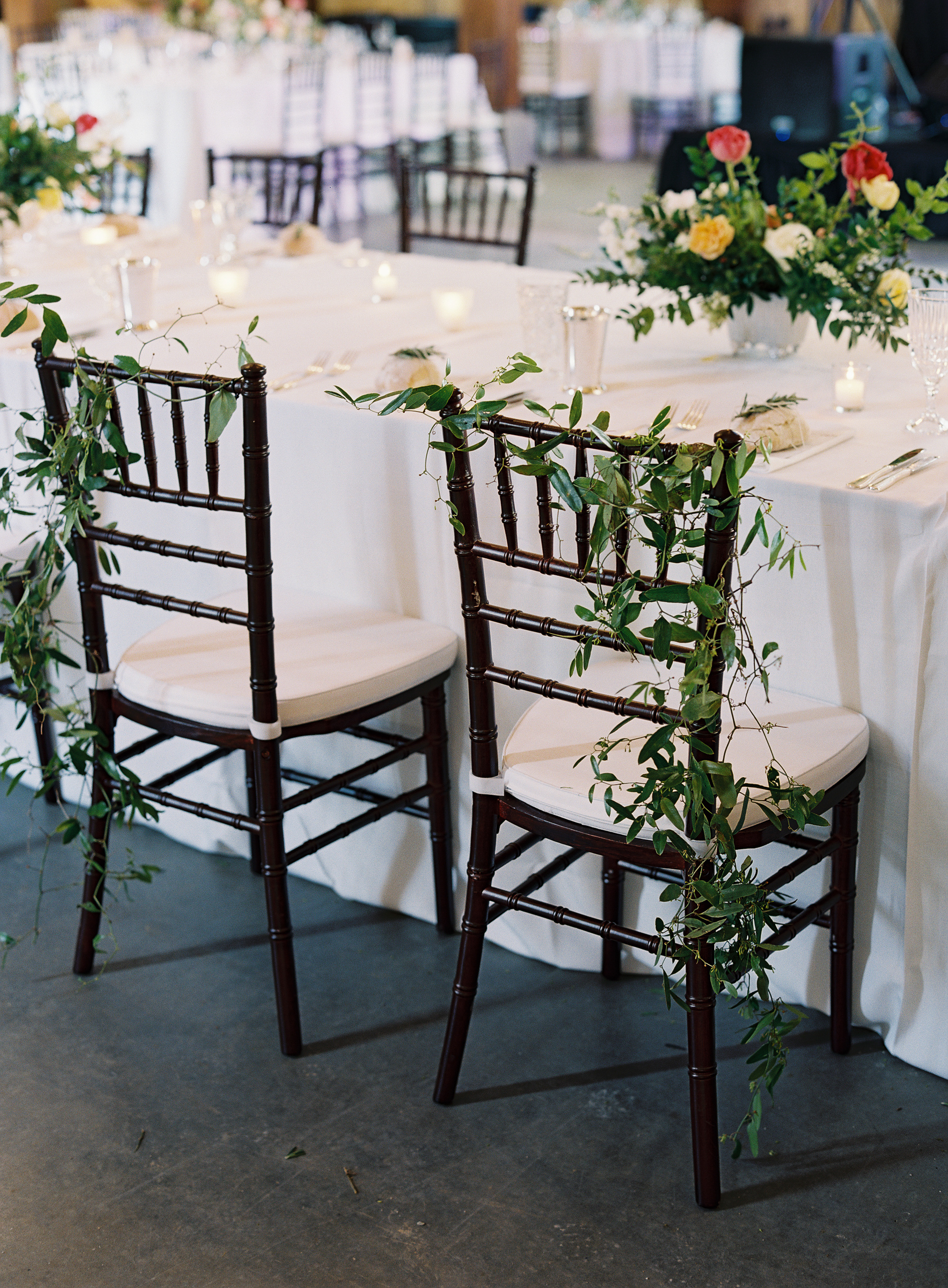 Airy greenery for the bride and groom's chairs // Nashville Wedding Floral Design