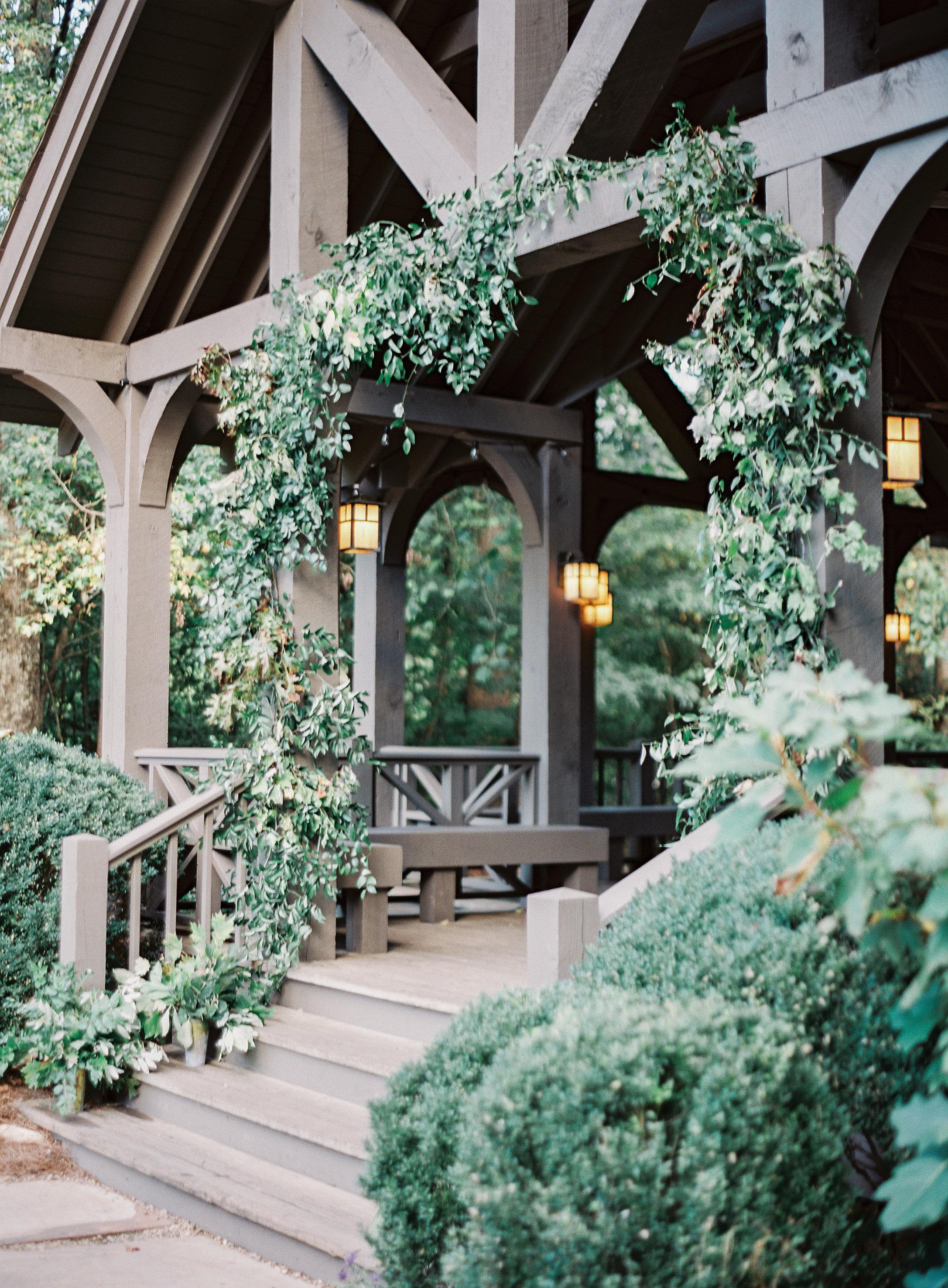 Lush greenery installation at the Yallerhammer Pavilion // Blackberry Farm Wedding Florist