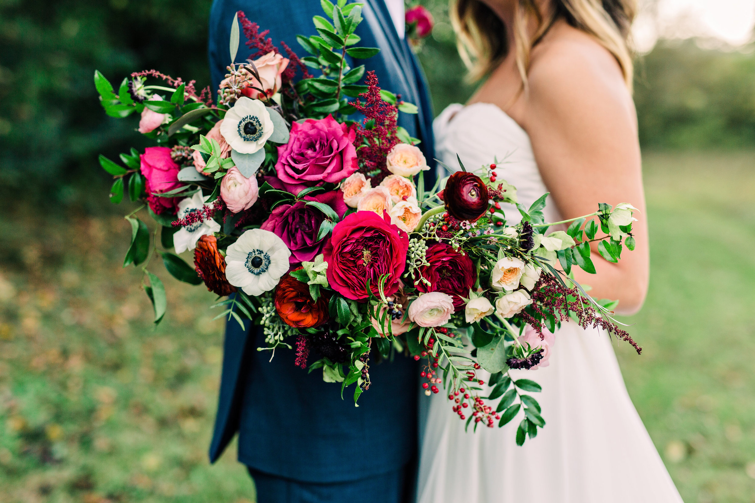 Lush, organic bridal bouquet with marsala ranunculus and garden roses // Nashville Wedding Floral Design