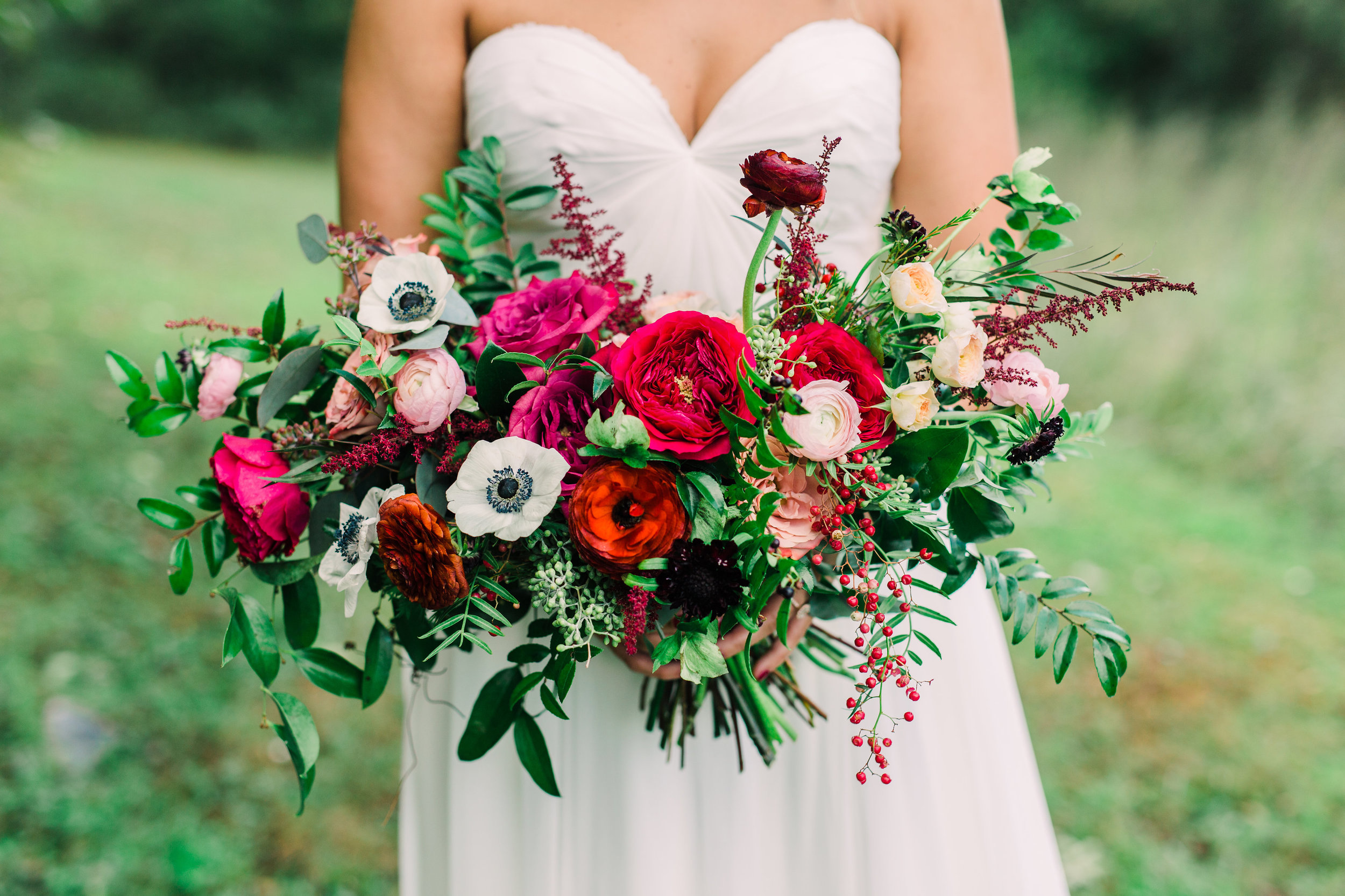 Natural bridal bouquet with marsala ranunculus, anemones, and trailing greenery // Nashville Wedding Floral Design