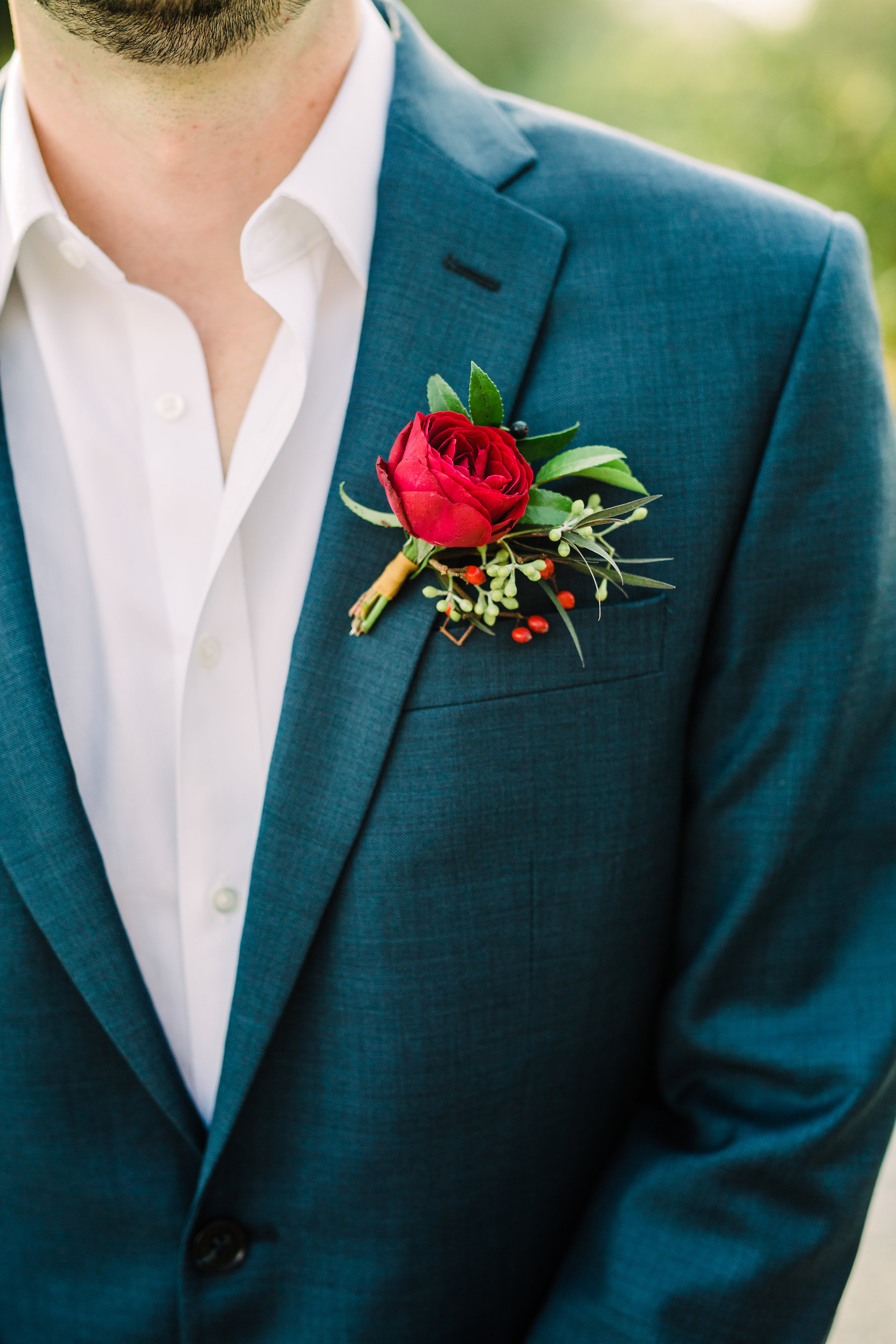 Simple burgundy and greenery groom's boutonniere