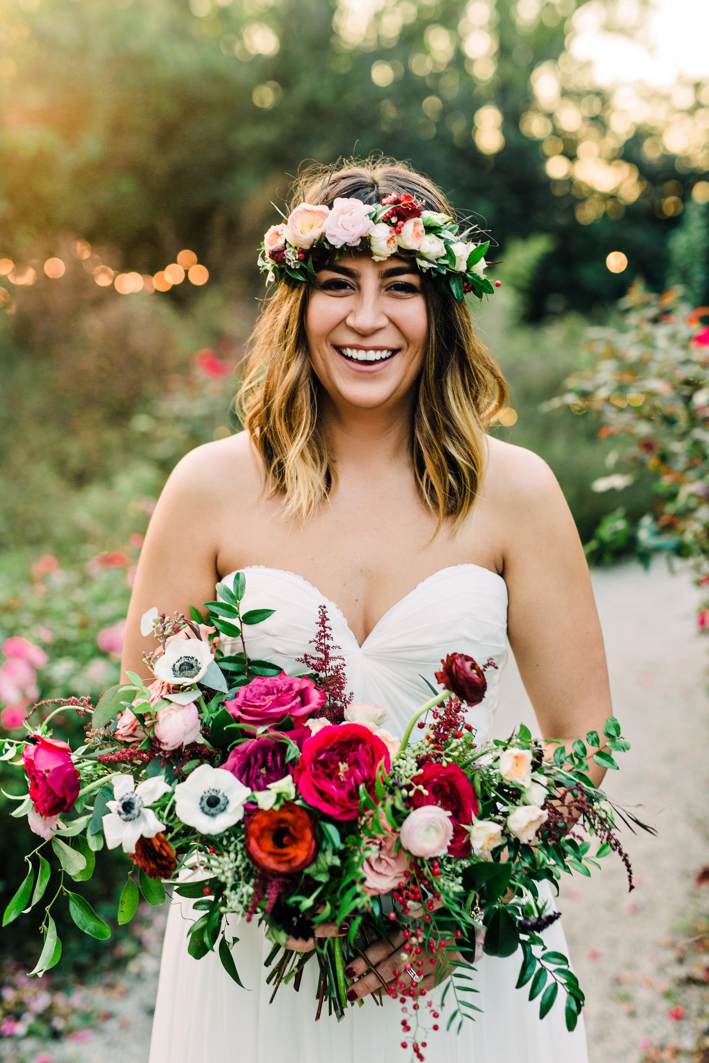 Lush, untamed wedding flowers using deep red and burgundy garden roses and ranunculus // Nashville Wedding Florist