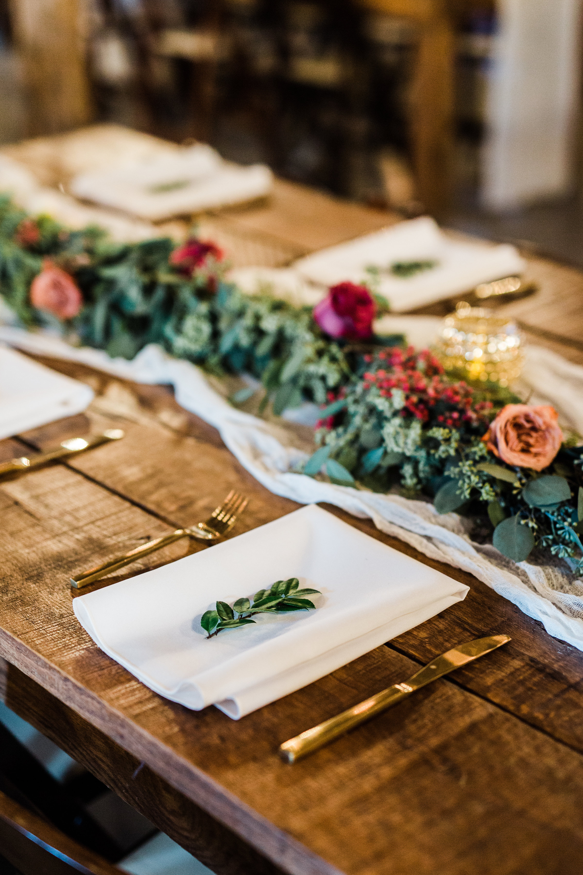 Lush greenery garlands on farm tables with marsala floral accents // Nashville Wedding Flowers