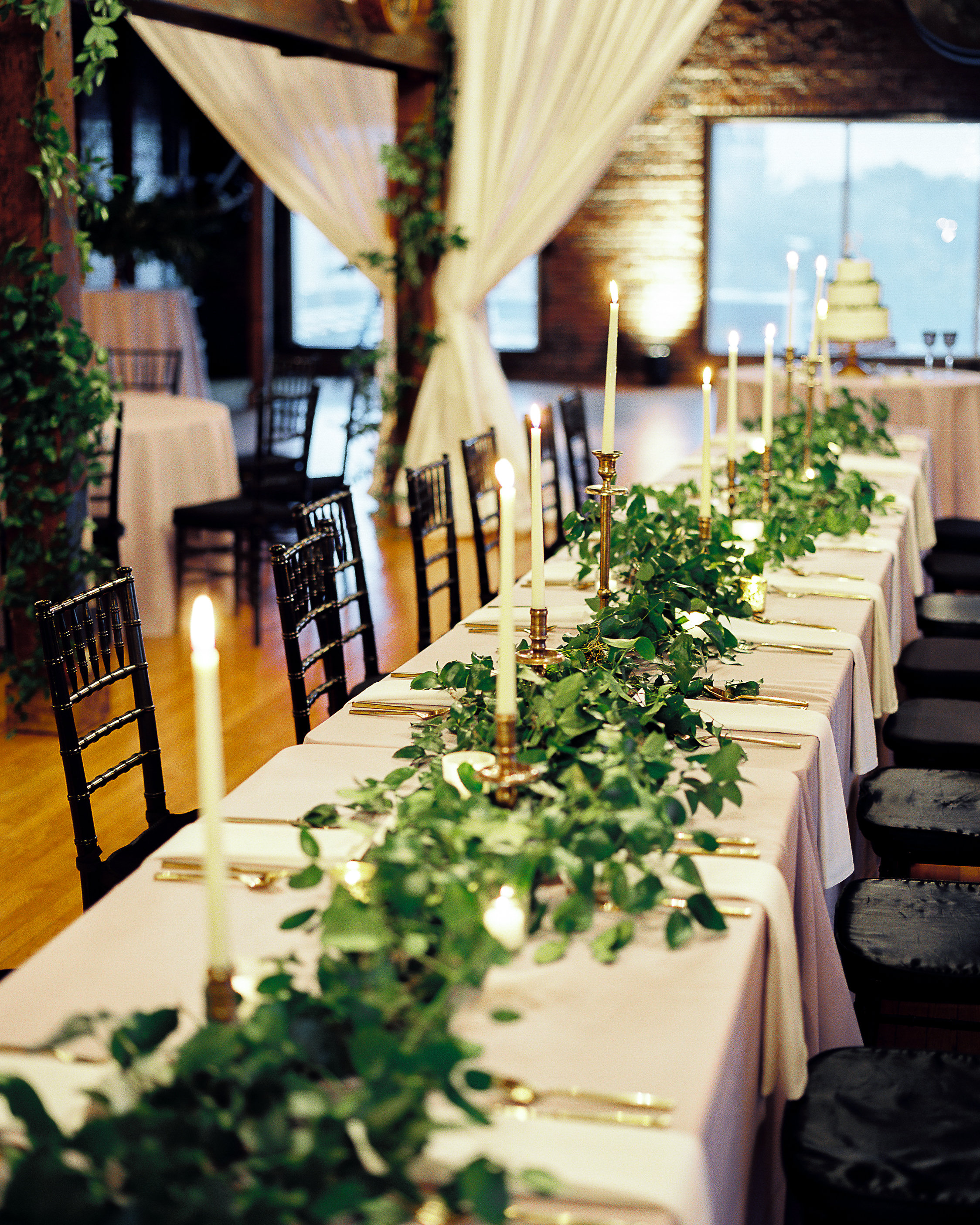 Natural greenery runner for the head table with brass candlesticks // Nashville Wedding Floral Design at Cannery One