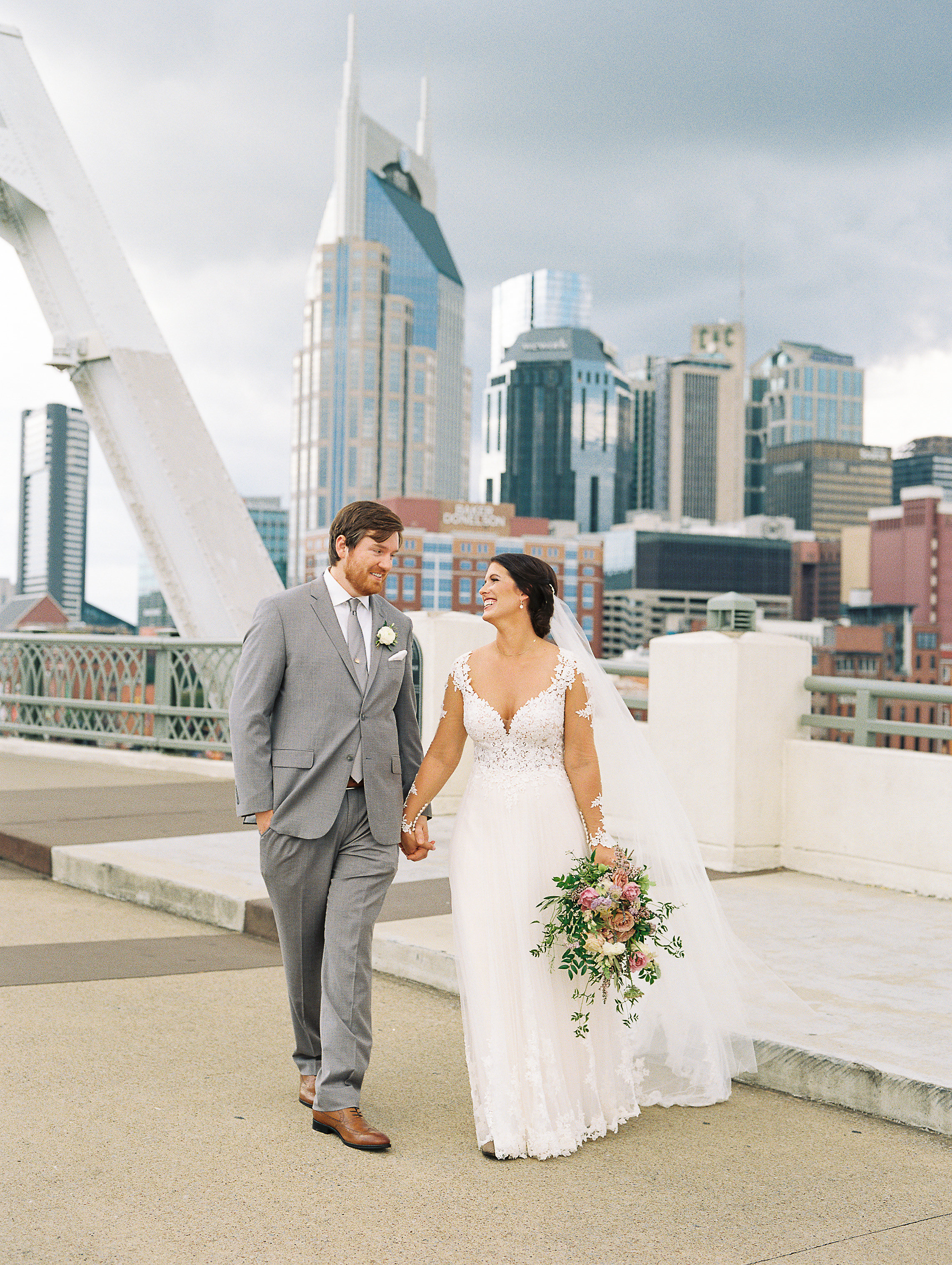 Lush greenery and lavender flowers // Newlywed portraits on the Shelby Bridge // Nashville Wedding Floral Design