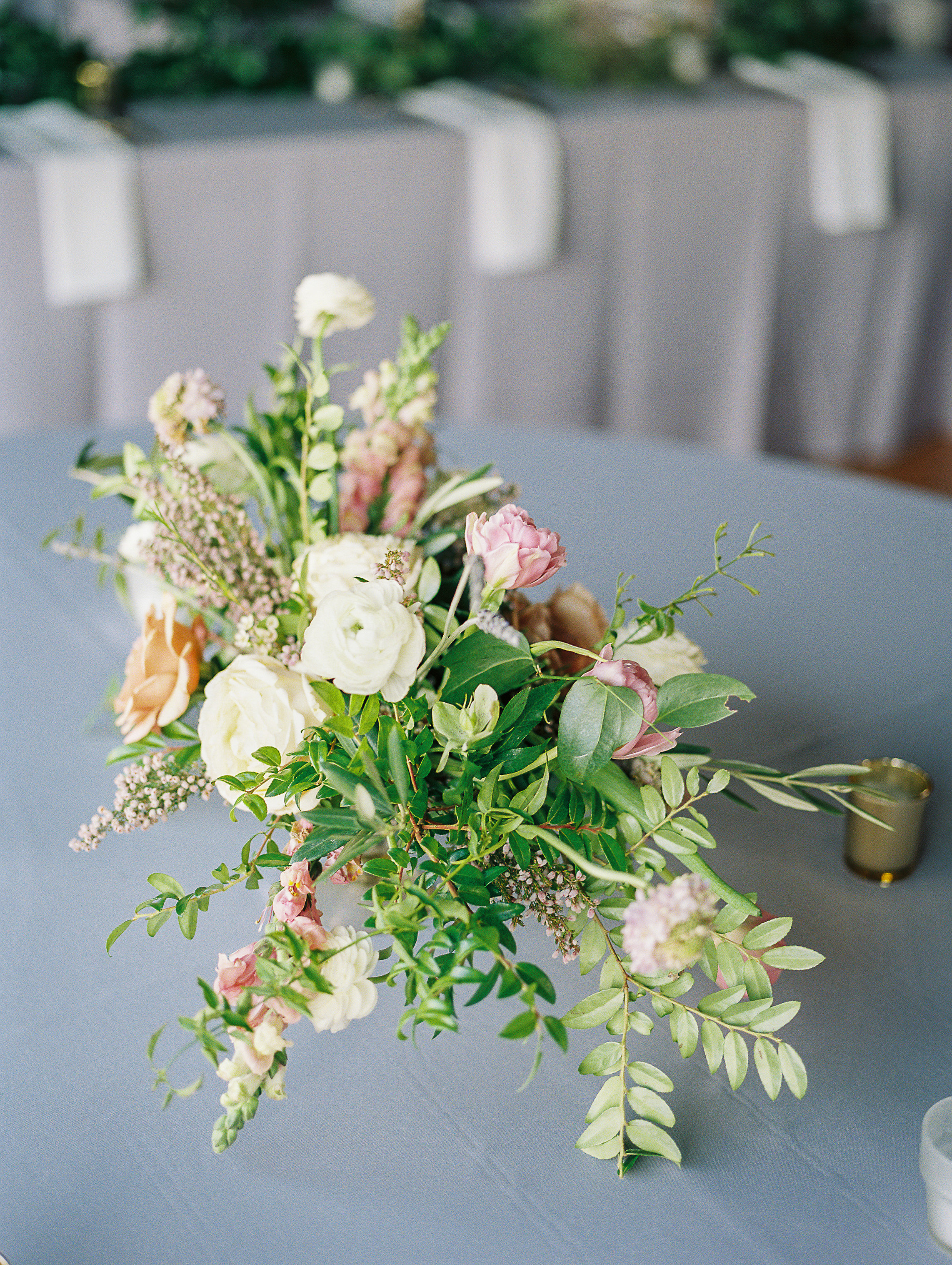 Low, organic centerpiece with white and lavender florals // Nashville Wedding Florist at Cannery One