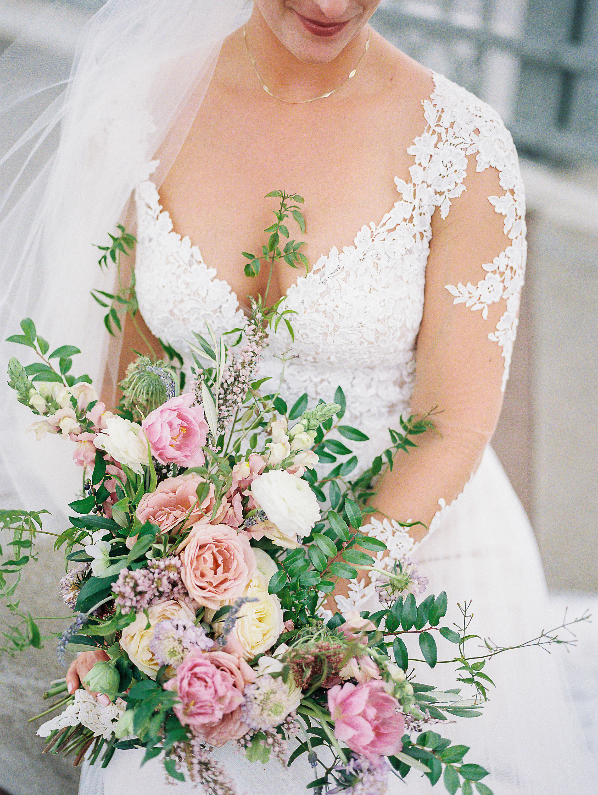 Natural, lush bridal bouquet with garden roses, ranunculus, and greenery // Nashville Wedding Floral Design