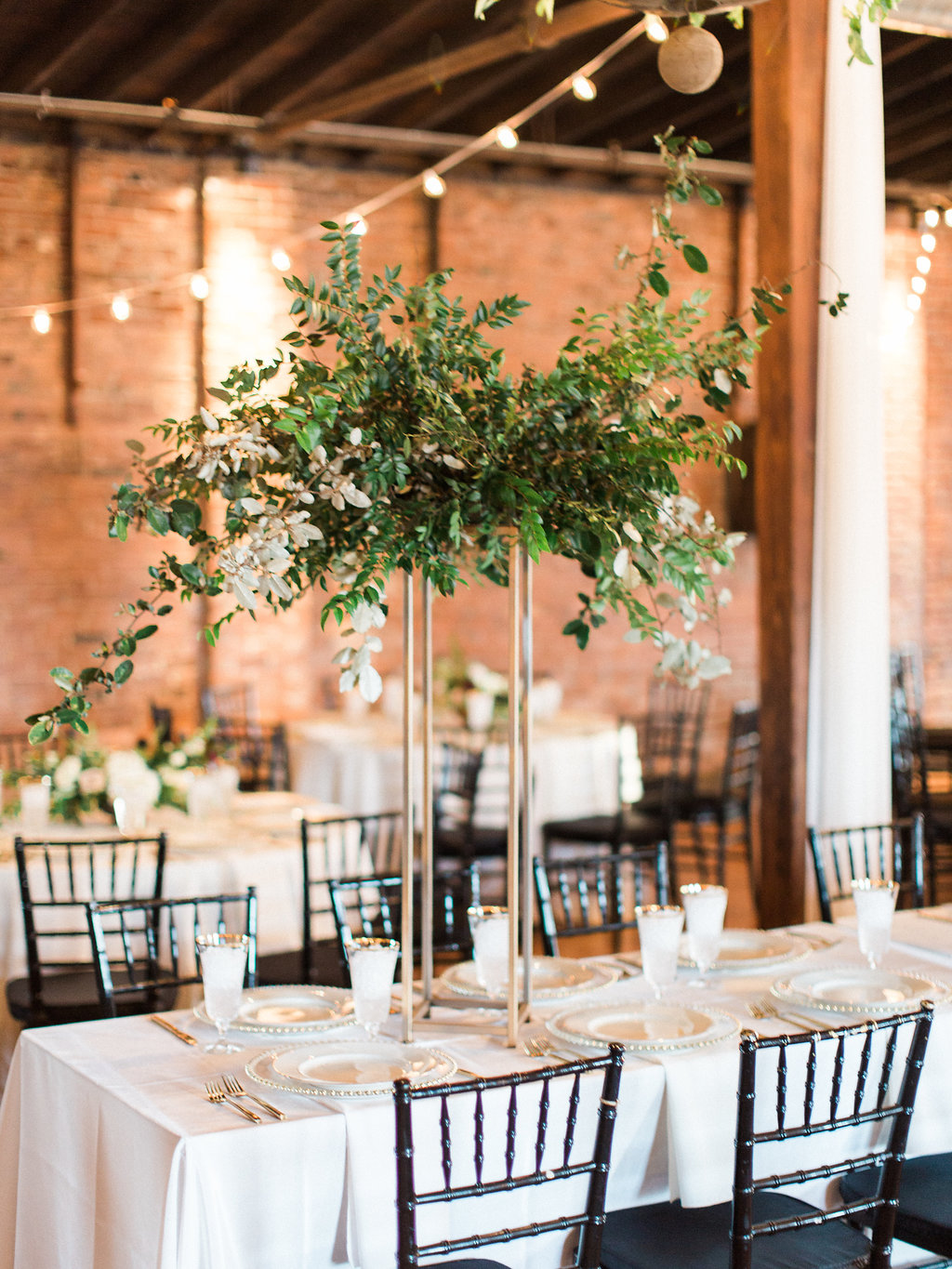 Modern gold stands with lush arrangements of all greenery for the head table // Nashville Wedding Floral Design