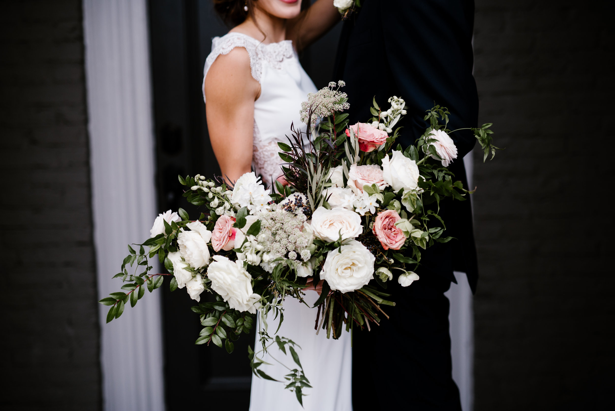 Muted, organic bridal bouquet with white, blush, and copper flowers // Nashville Wedding Florist at the Cordelle