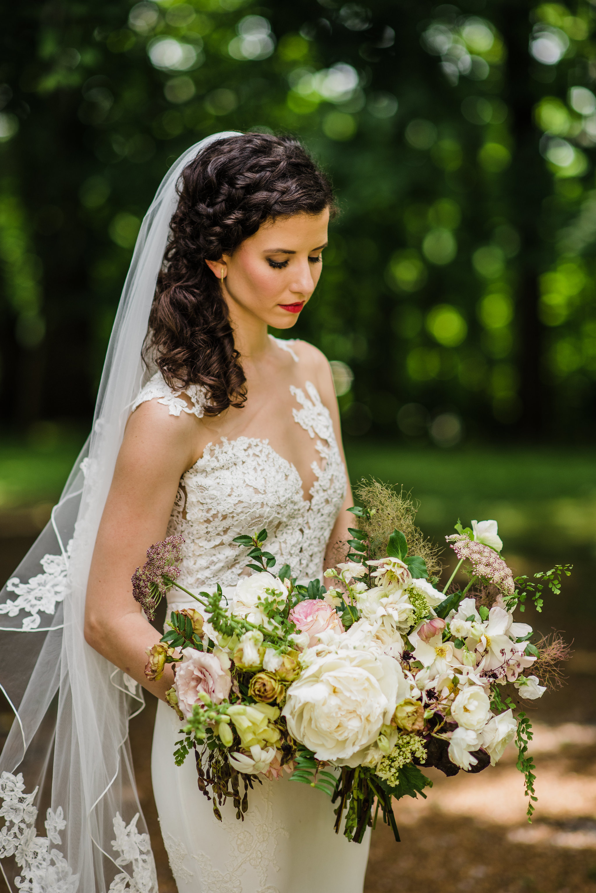 Organic, airy bridal bouquet with peonies, garden roses, greenery and lush textures // Nashville Wedding Florist